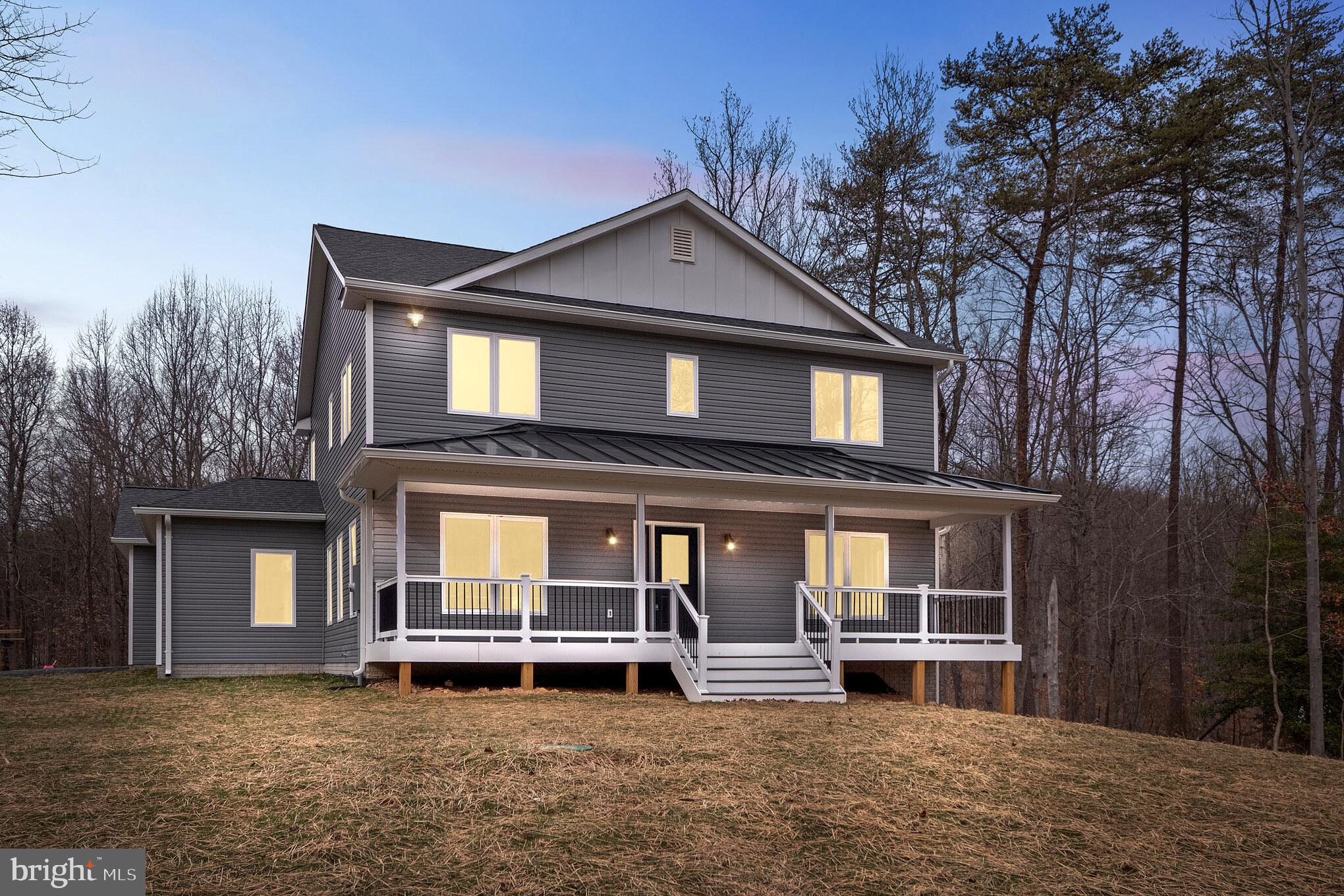 Great new construction home on 4 acres in Bluemont VA. This house offers 4 bedrooms with first floor