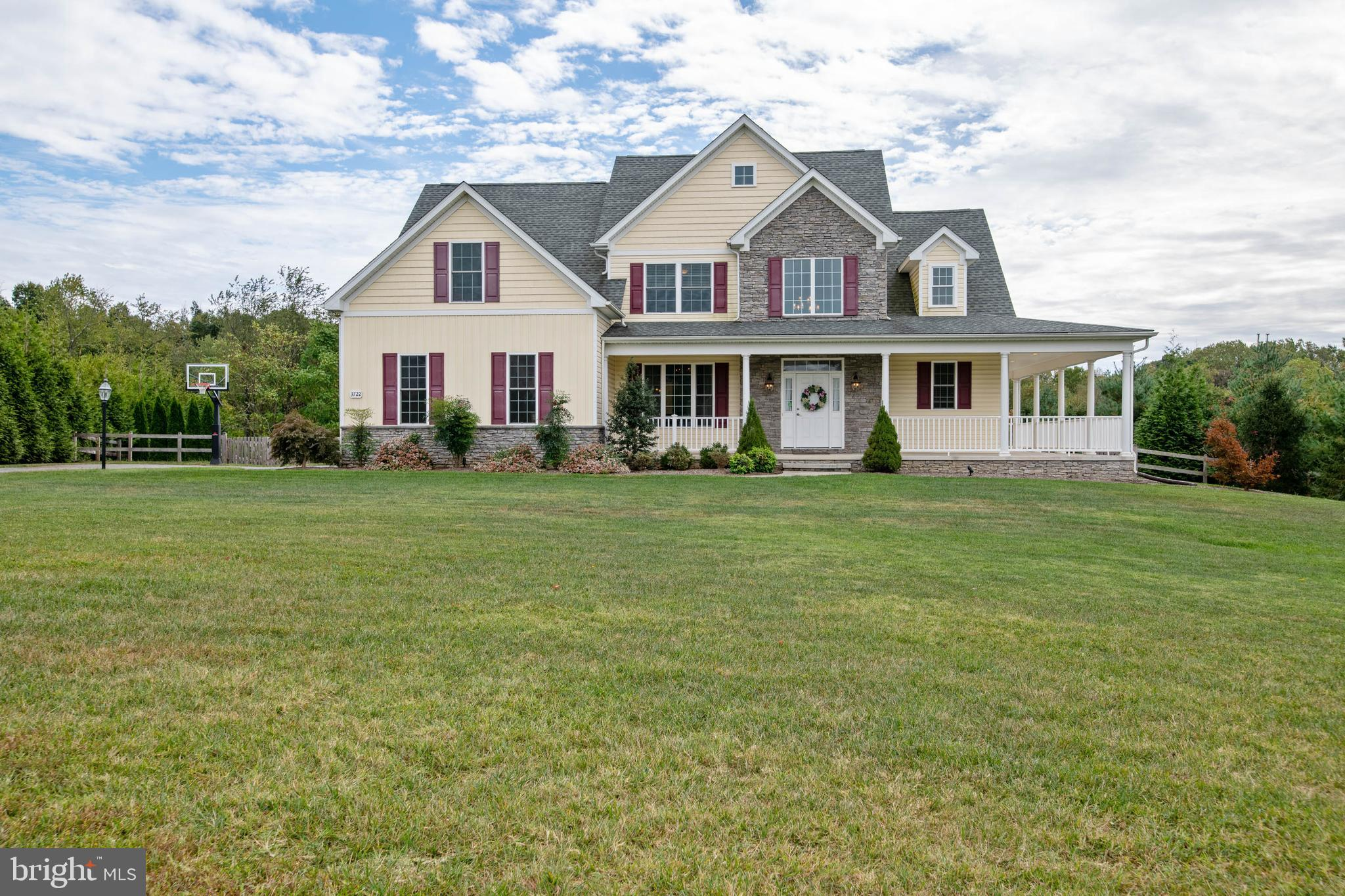 Turnkey property waiting for you! Beautiful home situated on fenced level yard with stone patio.  Un