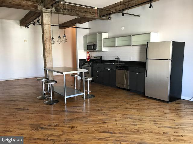 Top Floor Loft with 1 car assigned Parking in gated lot. Formerly an artist's materials warehouse, this 5 story wood and timber building has been converted into 30 Lofts. Original wood floors, large windows with juliet balcony facing north. Open kitchen/ living space. Kitchen has granite counters, stainless steel appliances and prep table. Full tiled bath with washer/dryer closet. Walking distance to center city, Chinatown ,RAIL PARK and more. Cafe Lift, Prohibition. Do your food shopping a few blocks to the 12th STreet Terminal Market Easy access to Major Highways, Septa and Broad STreet line.  Showings begin Oct 7th