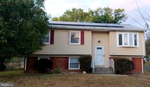 Lovely three bedroom split foyer! Light filled home with solar panels. Eat-in-kitchen with exit to n