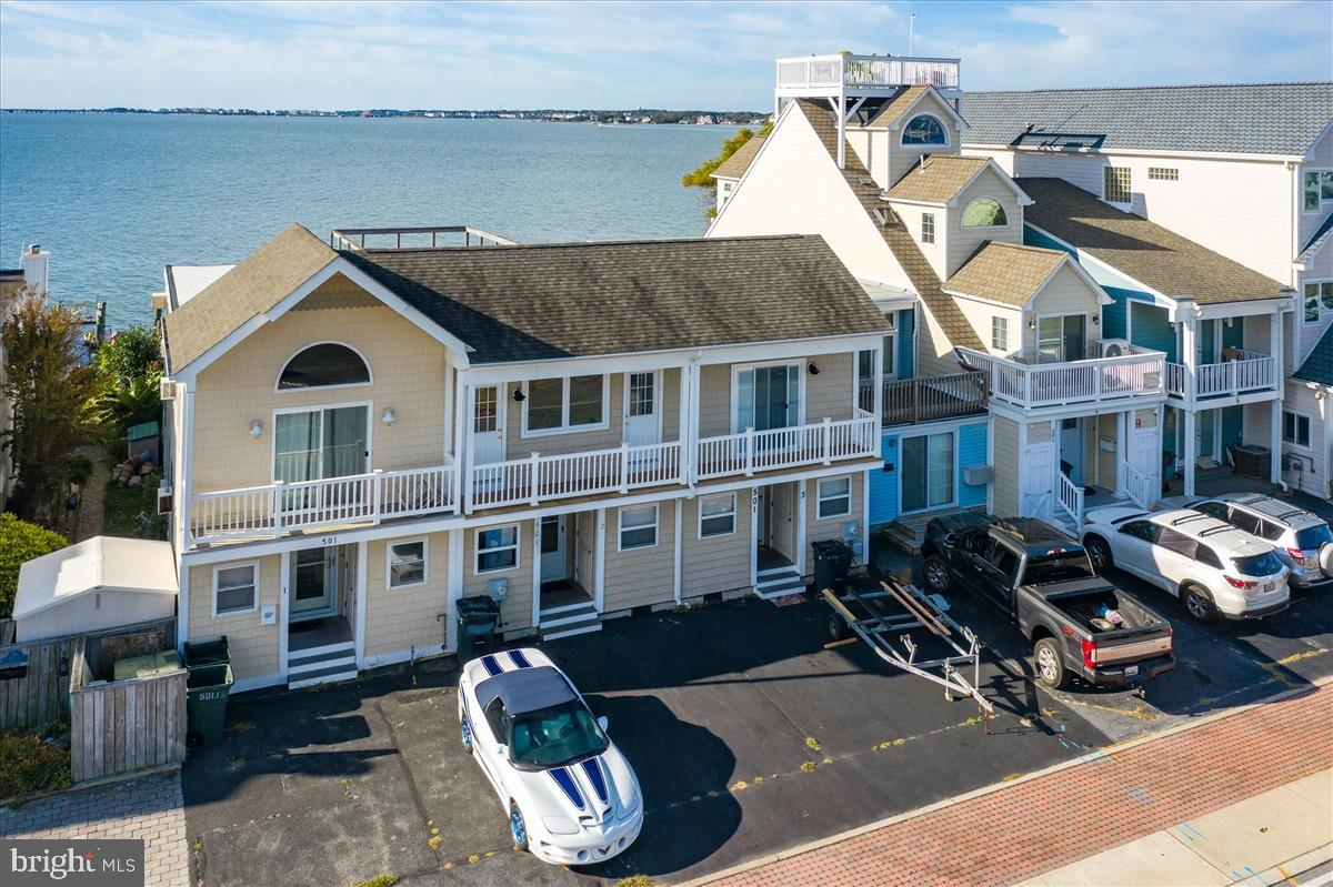 Direct Bay Front 2-level living, NO Condo Fee, land included with a yard for outdoor enjoyment and e