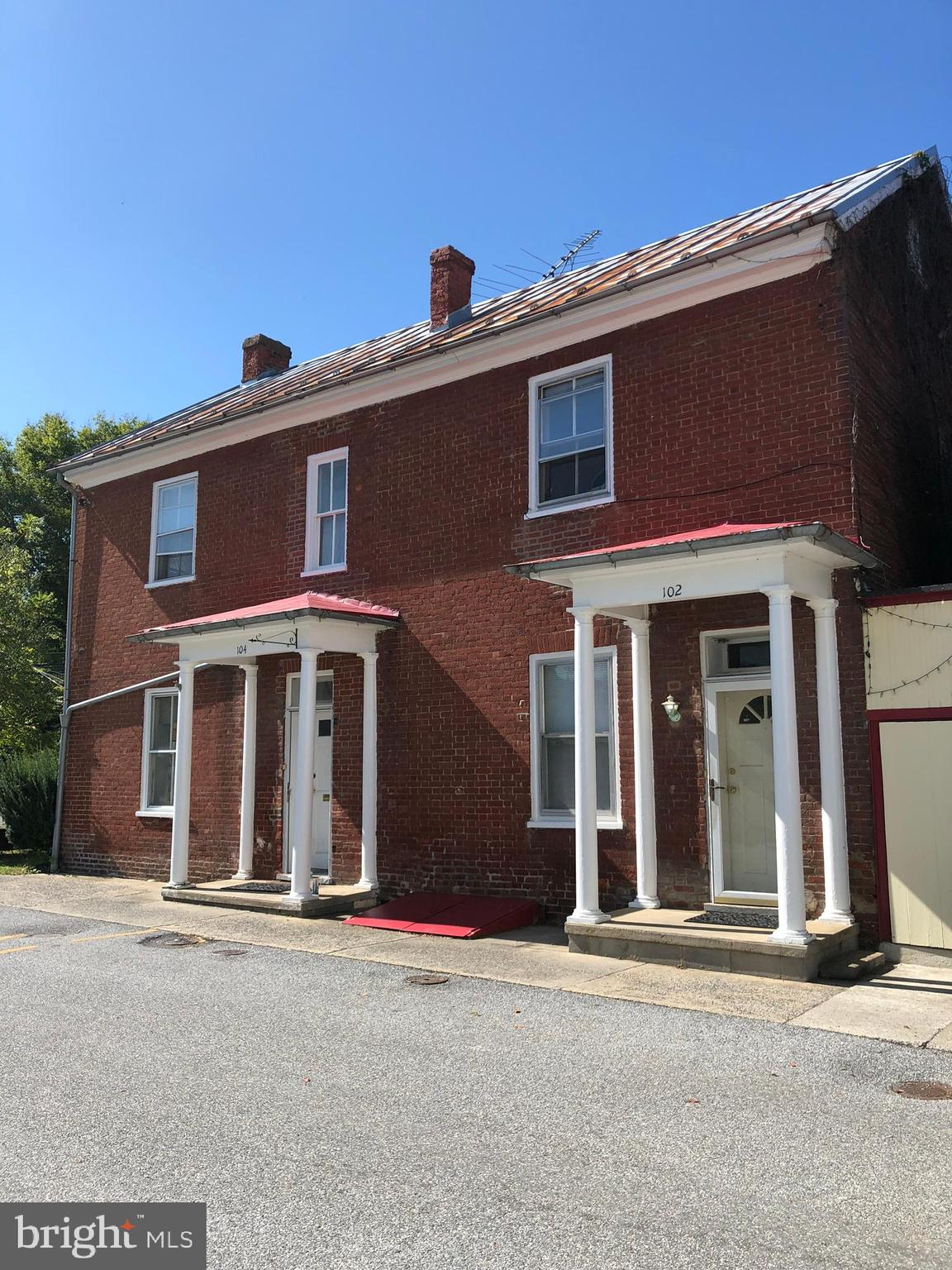 4 Unit Studio Apartment Building in the center of Shepherdstown. Live in one and rent the other unit