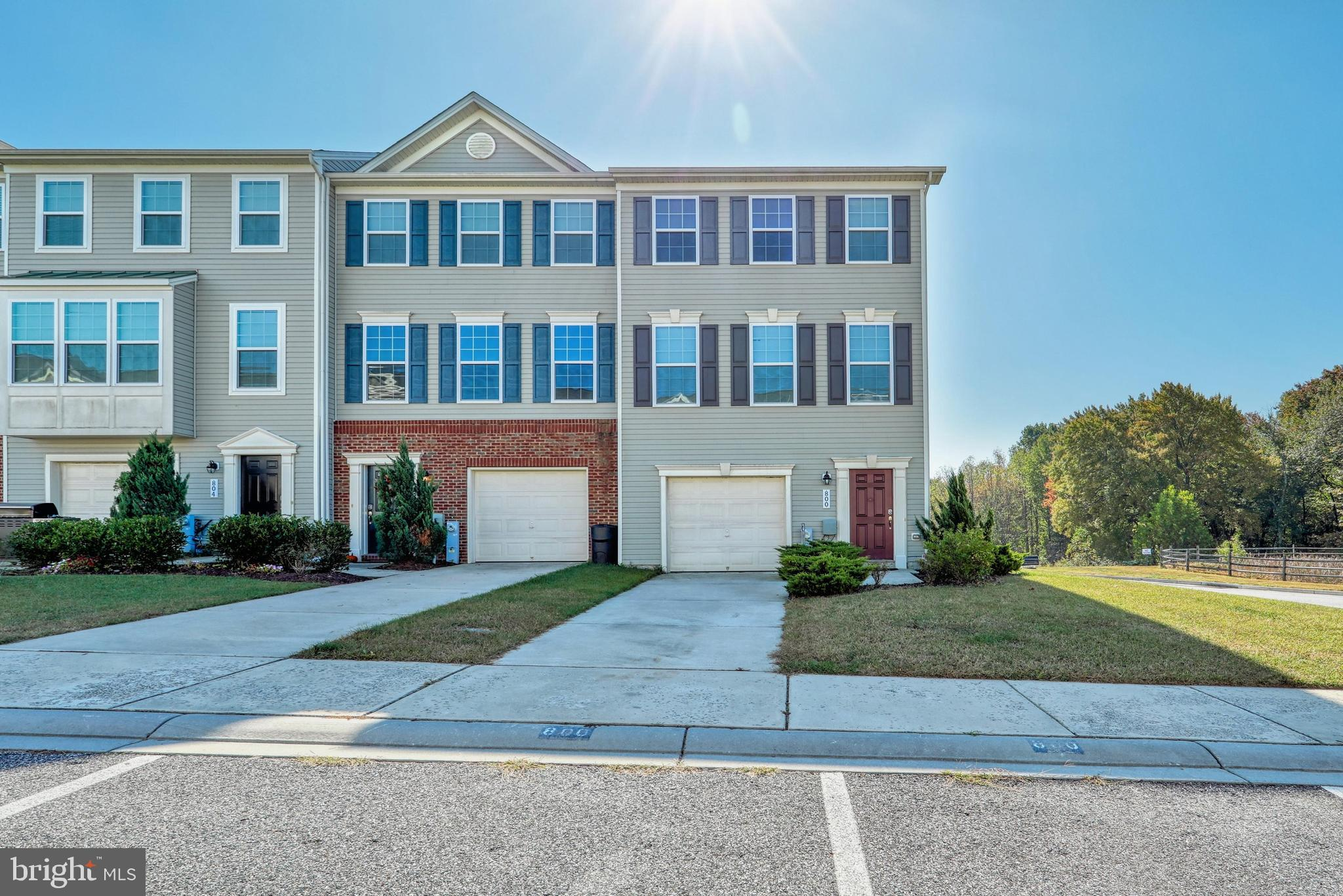 Move-in ready end of group featuring: Open kitchen/dining, kitchen island, stainless steel applaince