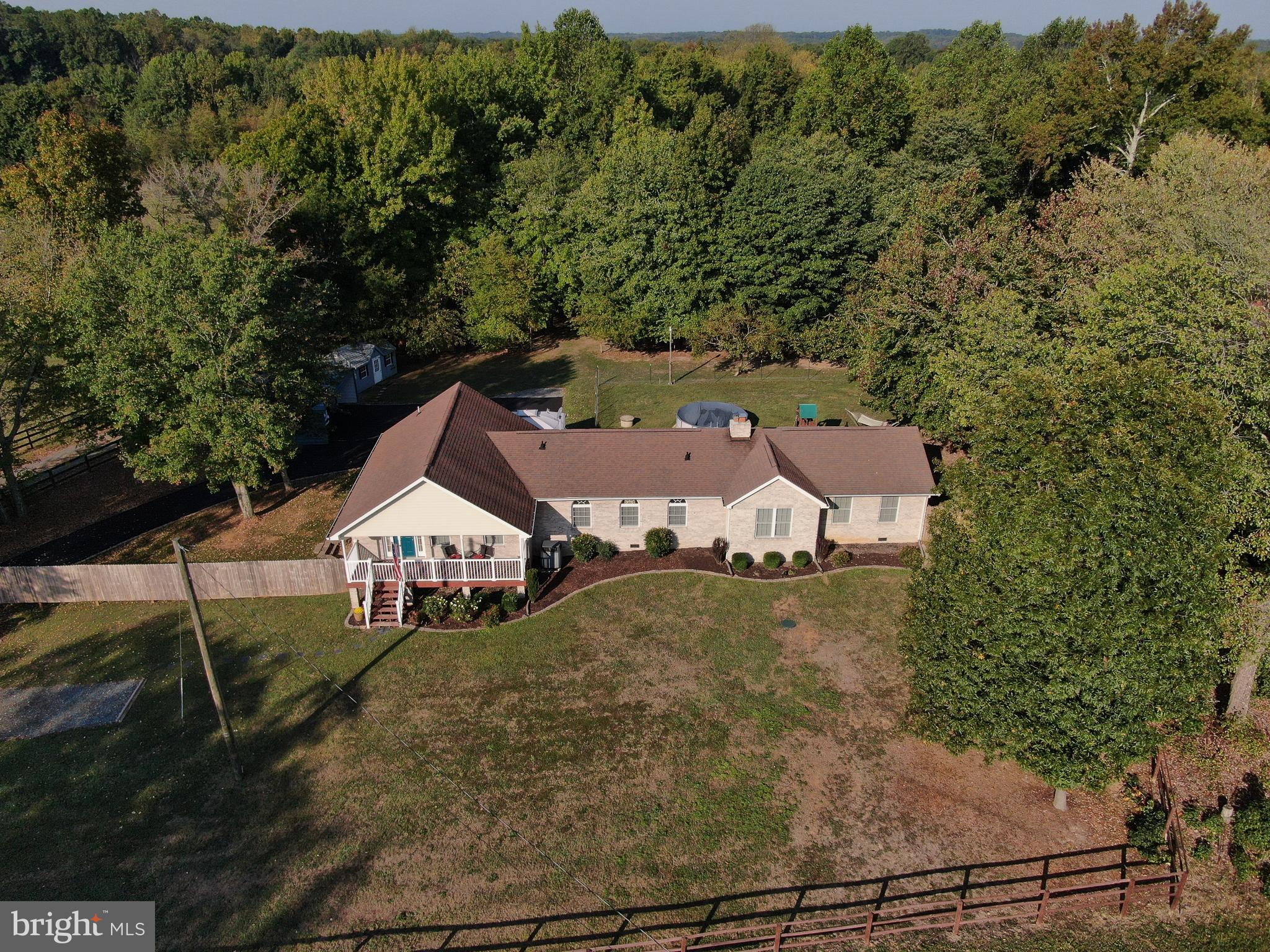 So much to love! This spacious raised rambler with main level living and an open floor plan, rests o