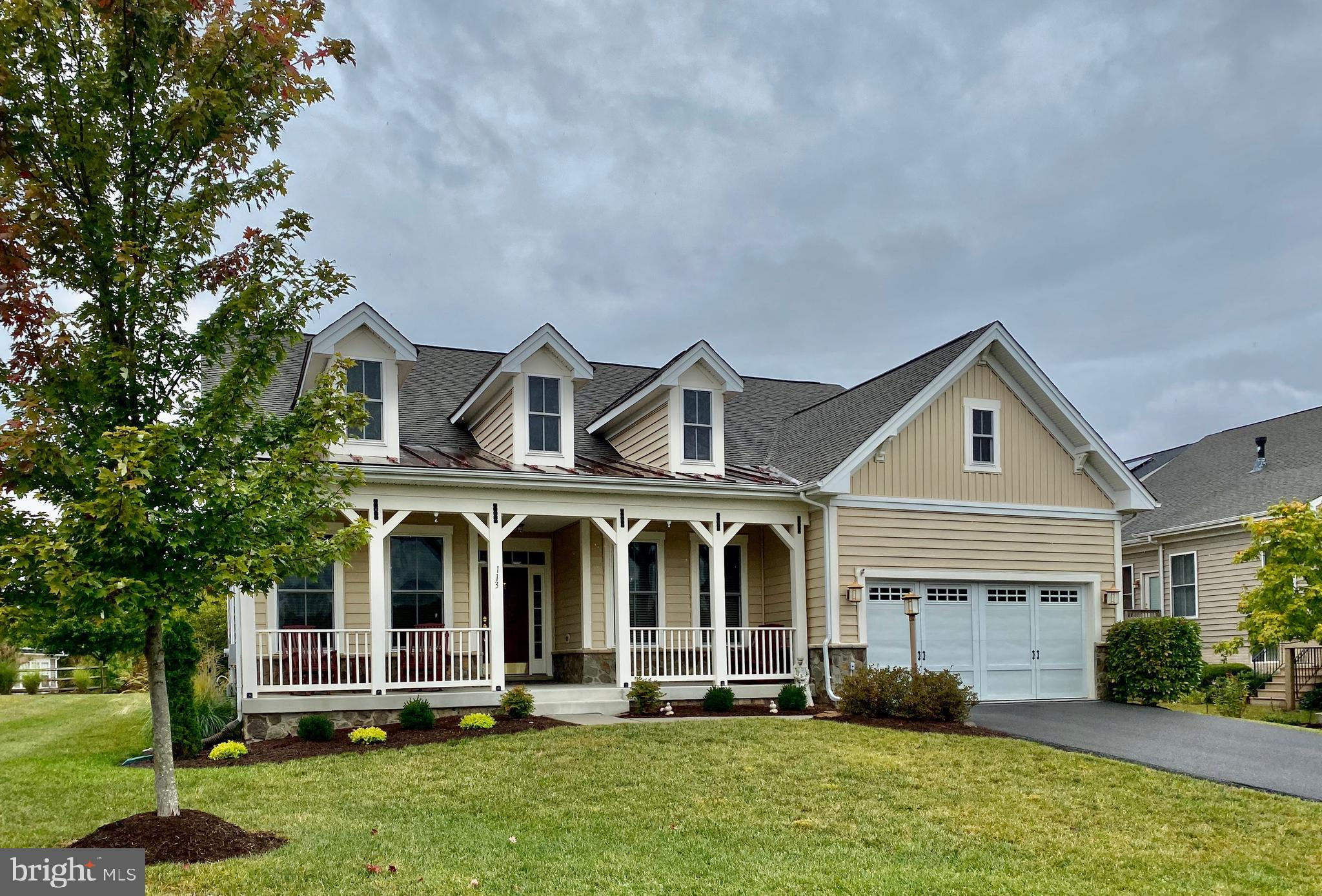 Beautiful craftsman home with lake access features an open floor plan with approximately 2,604 sq ft