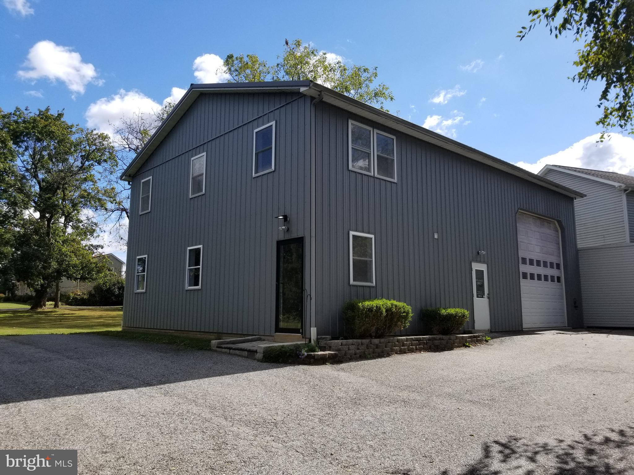 Great location with 1600sf office space and 800sf warehouse space. Offices feature natural lighting and central AC. Radiant flooring throughout the entire building.  200+ AMP service. Separate employee entrance, client entrance lobby door with waiting room/reception area, and drive-in door measuring approx 14'x14'. Kitchen area with countertops and sink. 3 private offices with storage closets. First floor features with restroom.  Rental Area includes building and parking areas. Owner is a PA Licensed REALTOR. Map doesn't show correct building. It is the 2-story shop.
