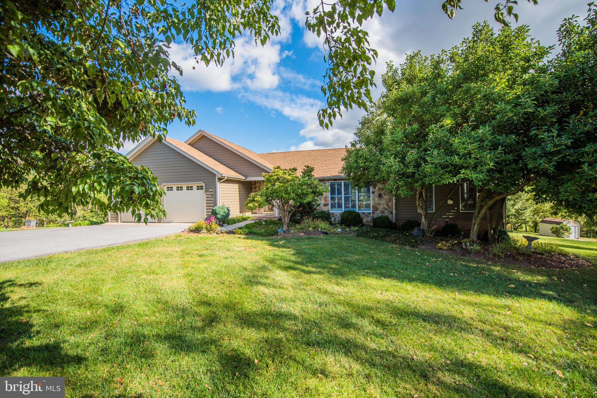 This lovingly cared for ranch home, finished on both levels with an awesome glass sun room addition,