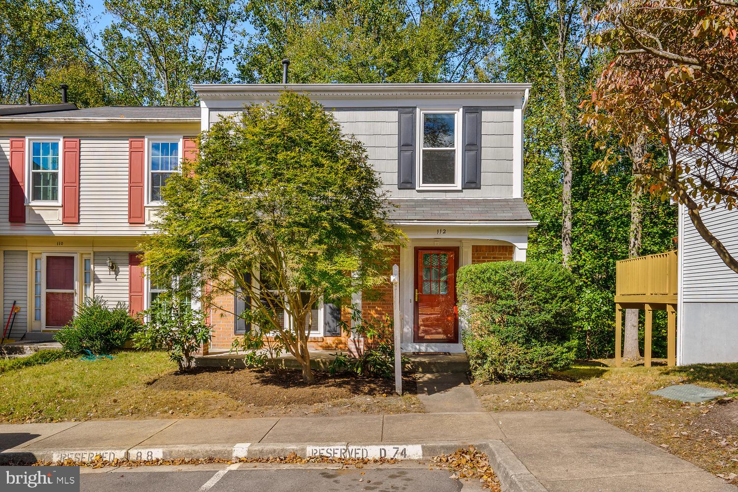 """Open Sun 10/13, 2-4. Park in space D74. UPDATED End-Unit nestled in trees of MC Parkland. Views from KT and Owner's Suite are spectacular & private! Must-see RENOVATED Kitchen w/Island. Soft-close, dowel joint, solid wood cabinets w/under cabinet lighting. 3/4"""" American Red Oak floors on entire main level. Both full BA's improved. Fun rec-room w/wood burning fireplace & sliders to paver patio. Carpet just installed on BR level. Fresh paint. Check Disclosures for details on upgrades & amenities."""