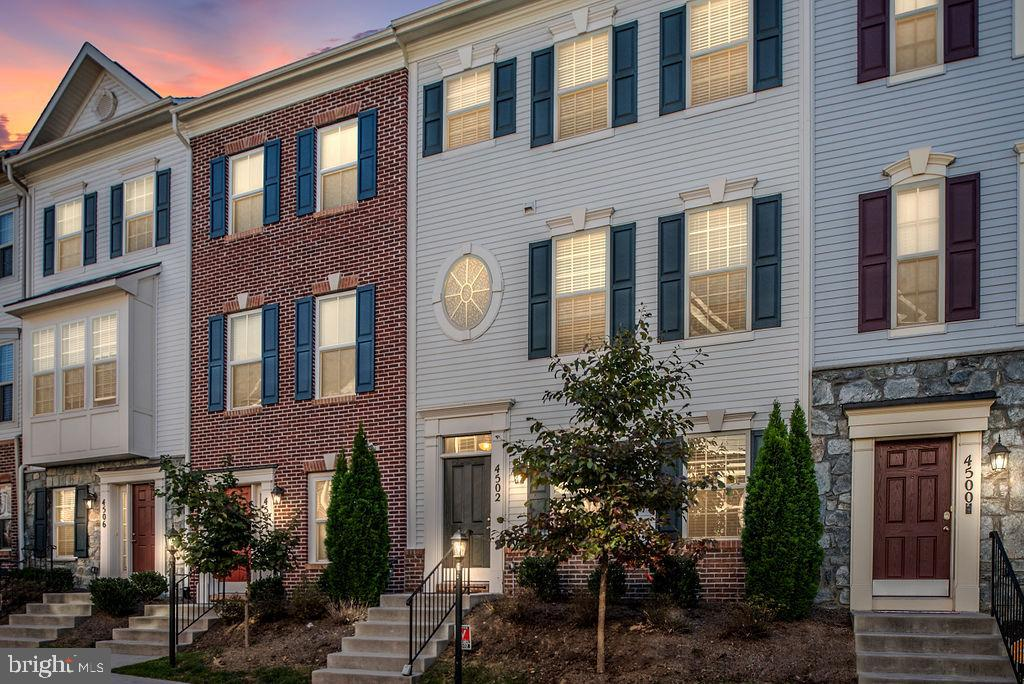 Welcome Home!! Beautifully maintained 4-story townhouse featuring a spacious open floor plan, gleami