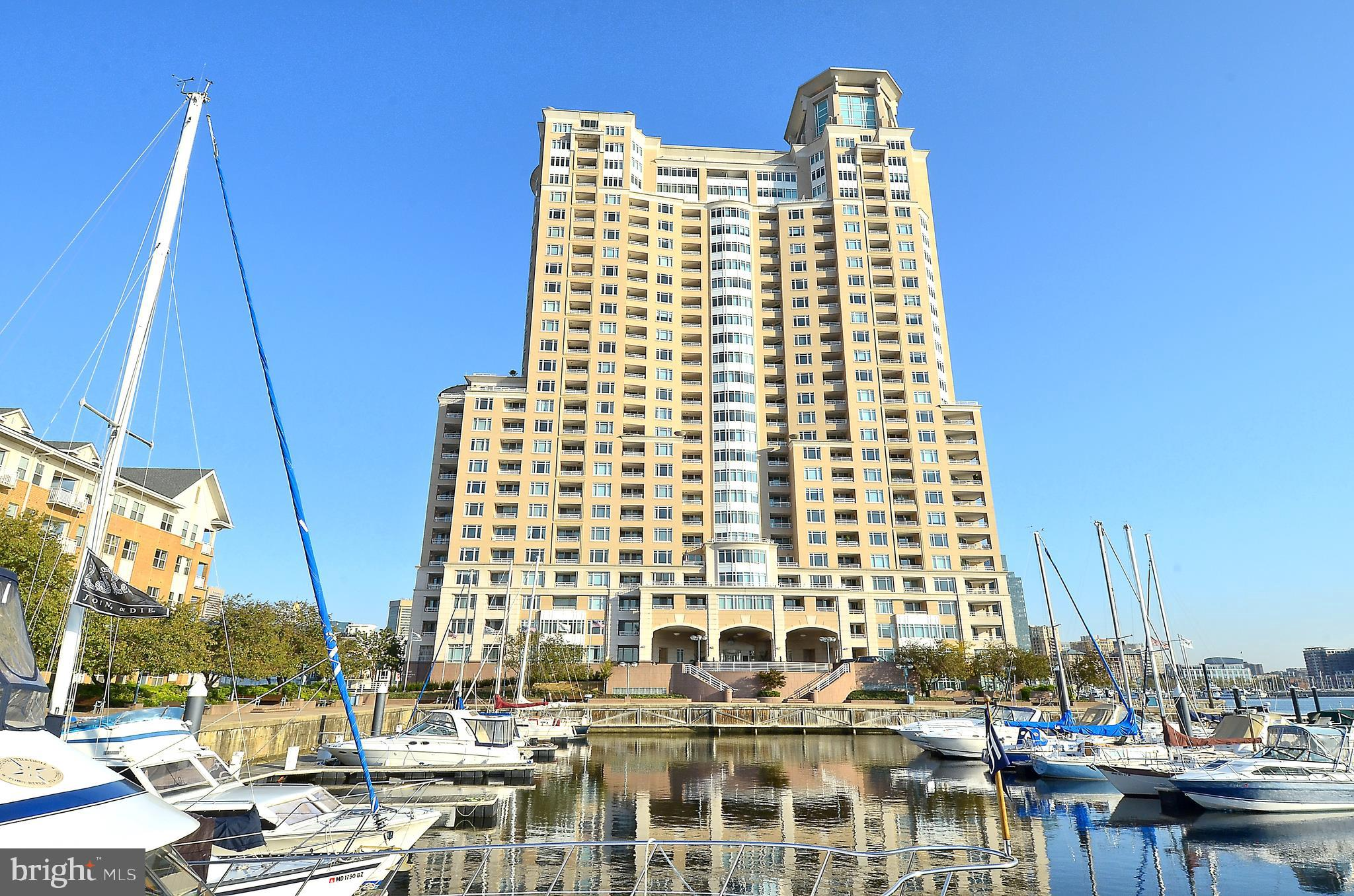 Combine urban chic, luxury living, incredible marina and harbor views and you will find yourself in The Harborview Towers.  An amazing variety of amenities at your doorstep.  In/outdoor pools, fitness center, personal and business meeting centers, social rooms, guest suites, concierge, valet services and much more.  Enjoy easy living in this super sun-filled one bedroom, one bathroom third floor unit.  Wood floors throughout, incredible harbor and marina views from your private balcony. The bedroom features picture windows with Harbor, Locust Point, Federal Hill and marina views, a walk-in closet with organizers and an exit to the private balcony.  The spacious living room offers the same spectacular view.  There is a dining space, breakfast bar area and room for the cook in the kitchen.  The HVAC was updated in 2015.  This unit comes with storage space and 1 assigned parking spot(P2-199).  Nearby attractions are endless. Shopping is convenient at McHenry Row (Harris Teeter, Dunkin Donuts, Starbucks), water taxi your way to Harbor East, Canton, Fells Point, easy access to BWI, Marc and Amtrak trains.  Take in a game at Oriole Park or M&T stadium, museums, Hippodrome, Royal Farms Arena and all within a few miles.  Garage Fee: $87.00 mo, Marina & Yacht Club Fee: $198.31 mo, Condo Fee: $859.25 mo.