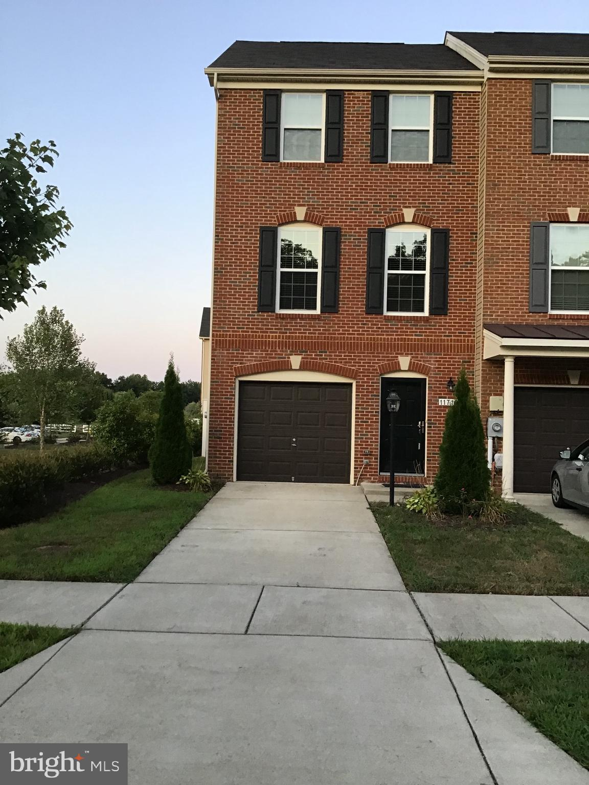 Beautifully maintained 3 level end unit townhouse with open floor plan. kitchen with granite counter