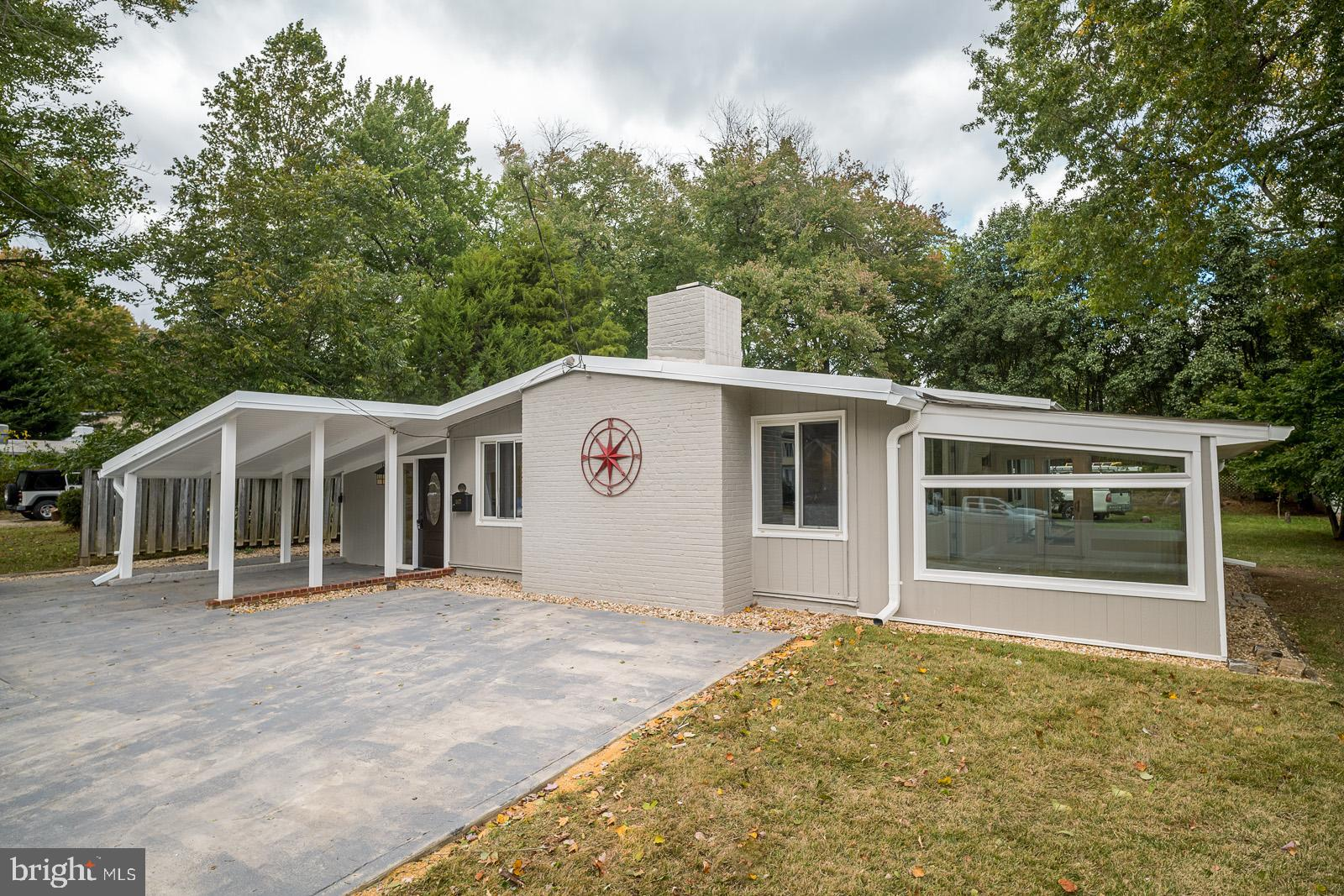 Sought after Mid-Century Contemporary on 1/4 acre +. 1600 sq ft - FULLY RENOVATED. Large year-round