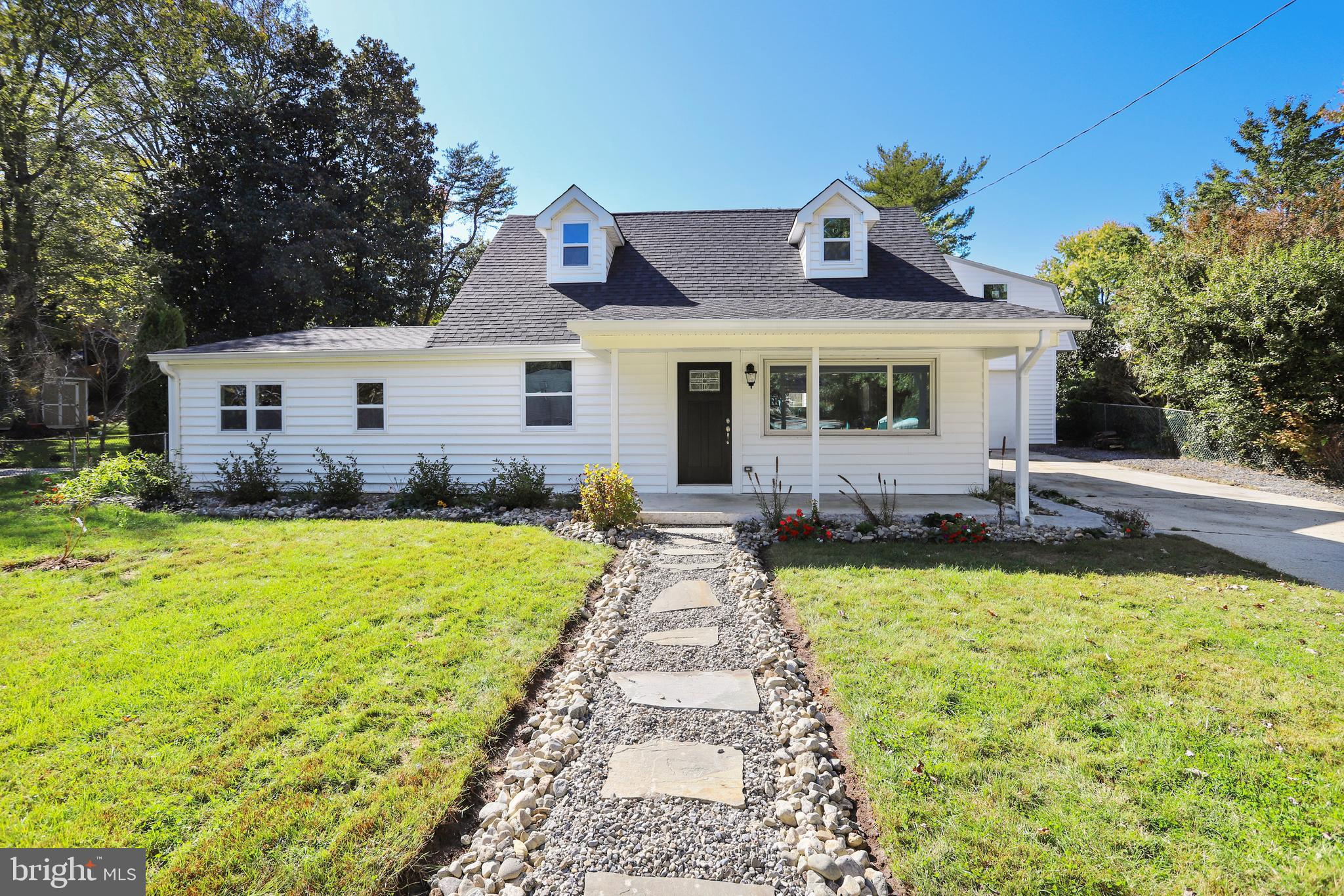 Beautifully redone Cape Cod inside and out, sought after Belevedere Heights/Mago Vista located on qu