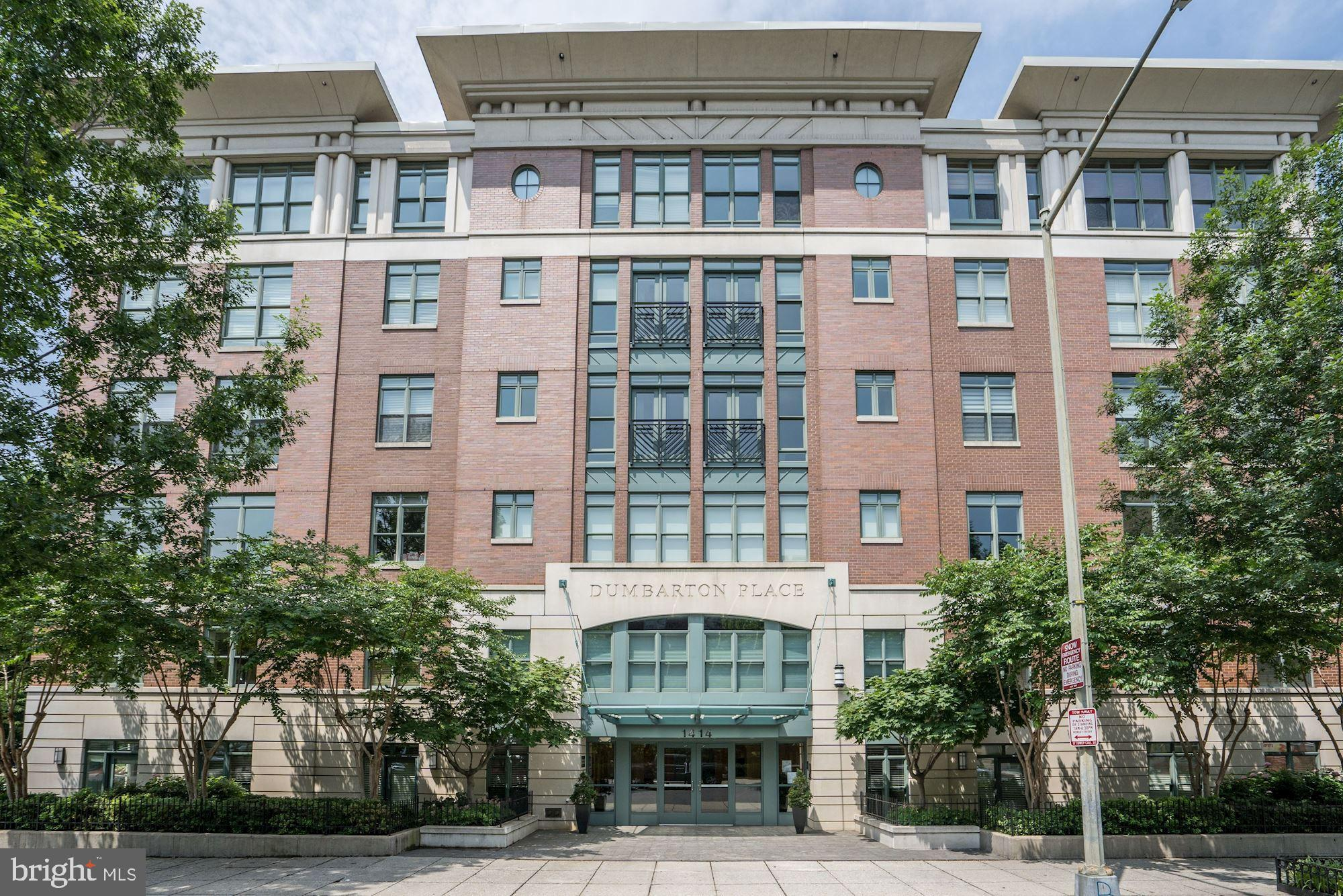 NEW LISTING! Dumbarton Place #42 offers turnkey living in an unparalleled location, with verdant gre
