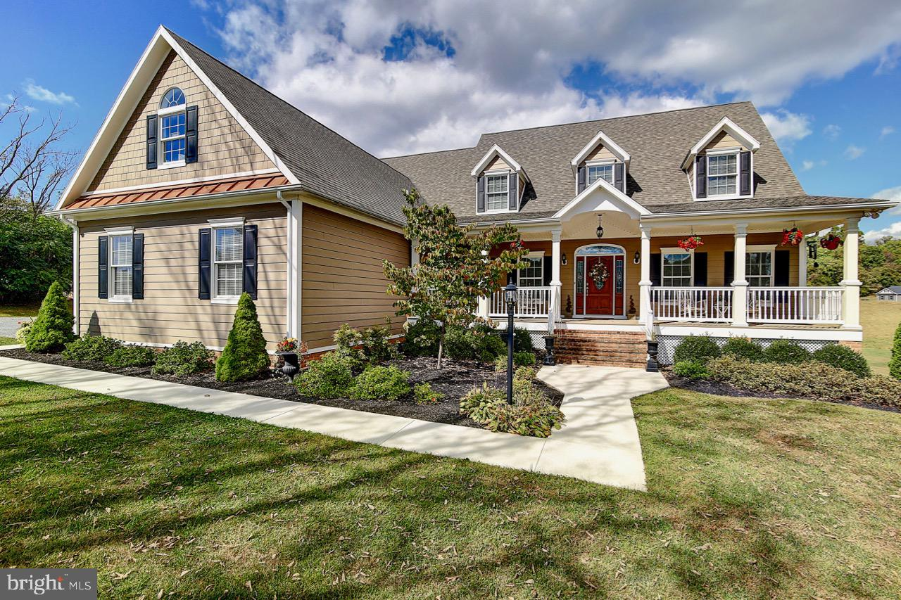 This gorgeous turn-key Cape Cod features over 5,300 sq. ft with 4 bedrooms, 3 full bathrooms, and 1