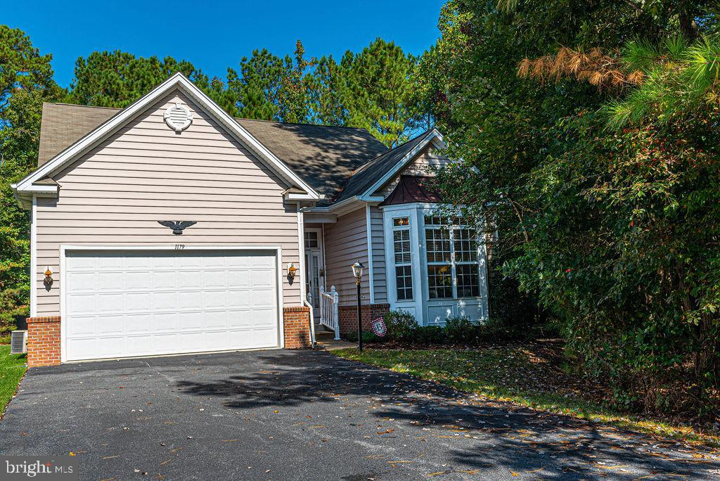 Beautiful and private home on almost half an acre, in the Premier 55+ Community in Ocean Pines.This