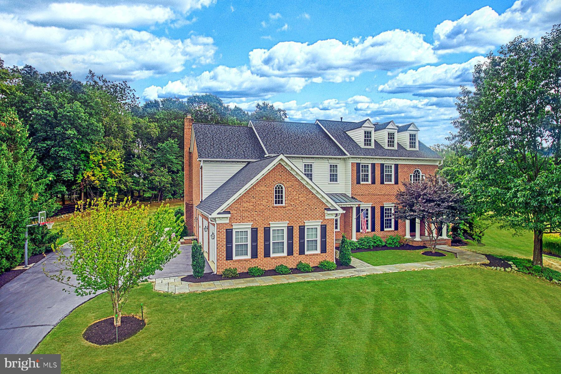 Situated on an elevated 3-acre estate lot in Beacon Hill, this stately all brick custom residence bu