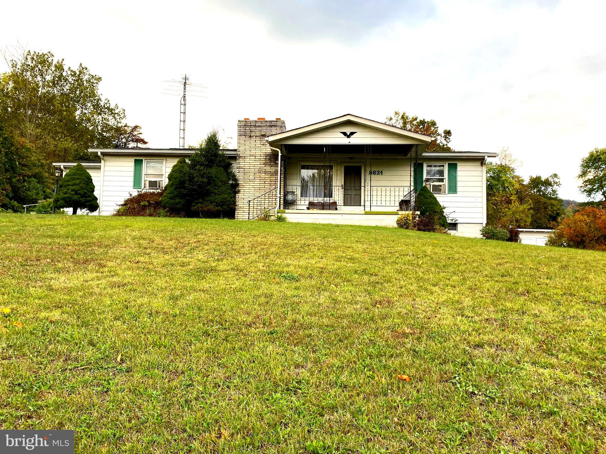"""Great investment opportunity or first home with a little TLC. Being sold """"AS IS"""".  This home offers"""