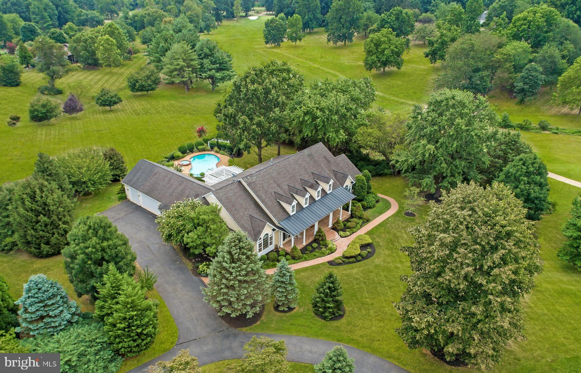 """Beautiful custom """"Southern Living' home on 2 acres in the sought-after Evergreen Farm golf course co"""