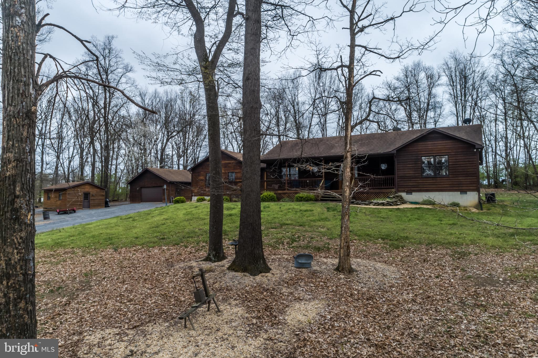 E-This Cedar Siding Rancher located on 6.25 ACRES.  Kitchen features Custom Hickory Cabinets,Granite