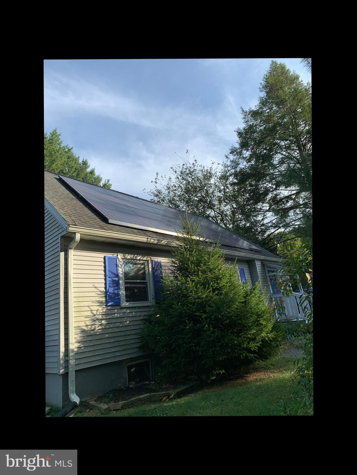 Spacious one acre Cape Cod with a huge yard! This home has plenty of outdoor space for whatever your