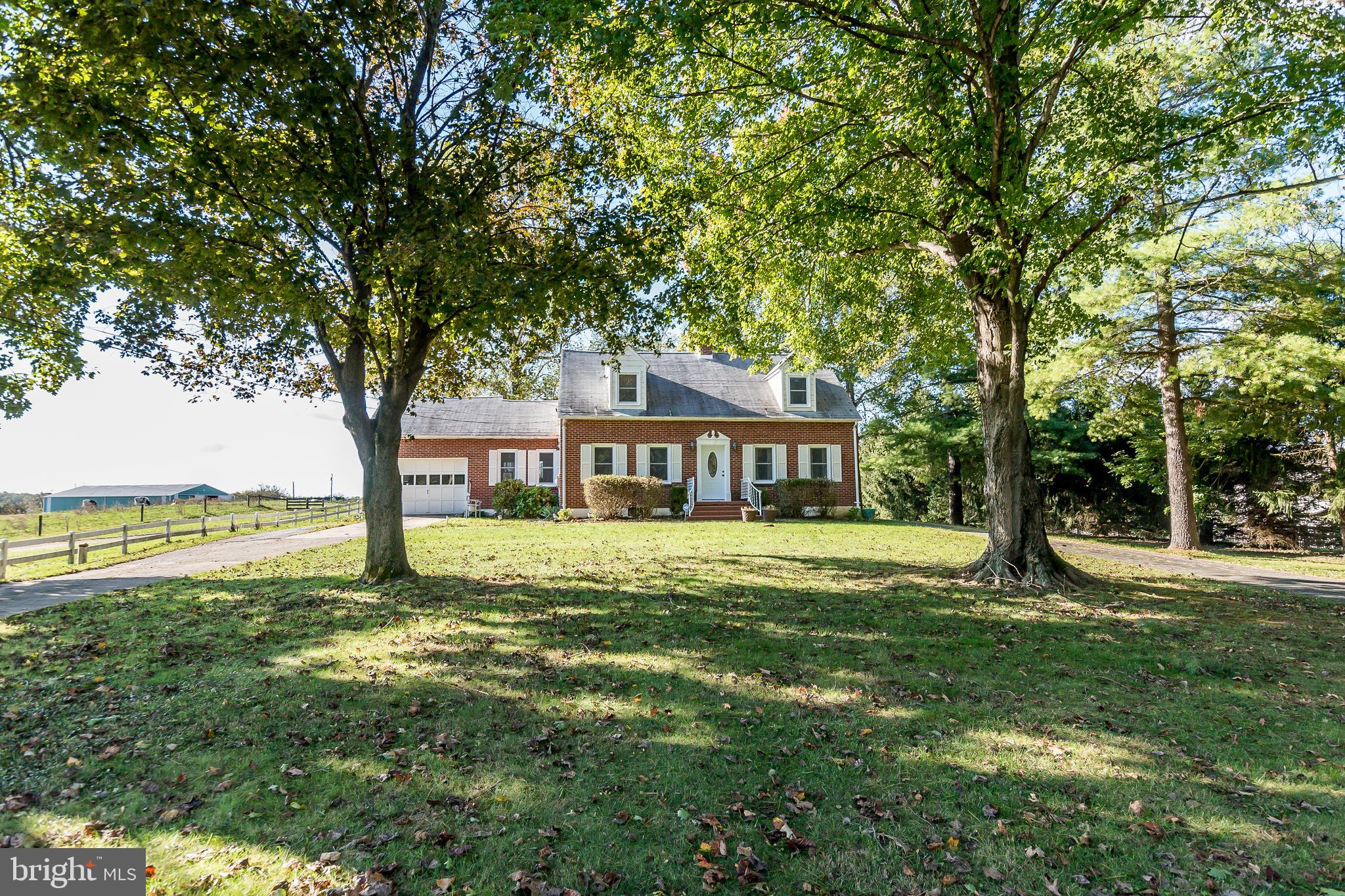 Gorgeous all brick Cape Cod situated in a park-like setting, just 1 mile from Downtown Shepherdstown