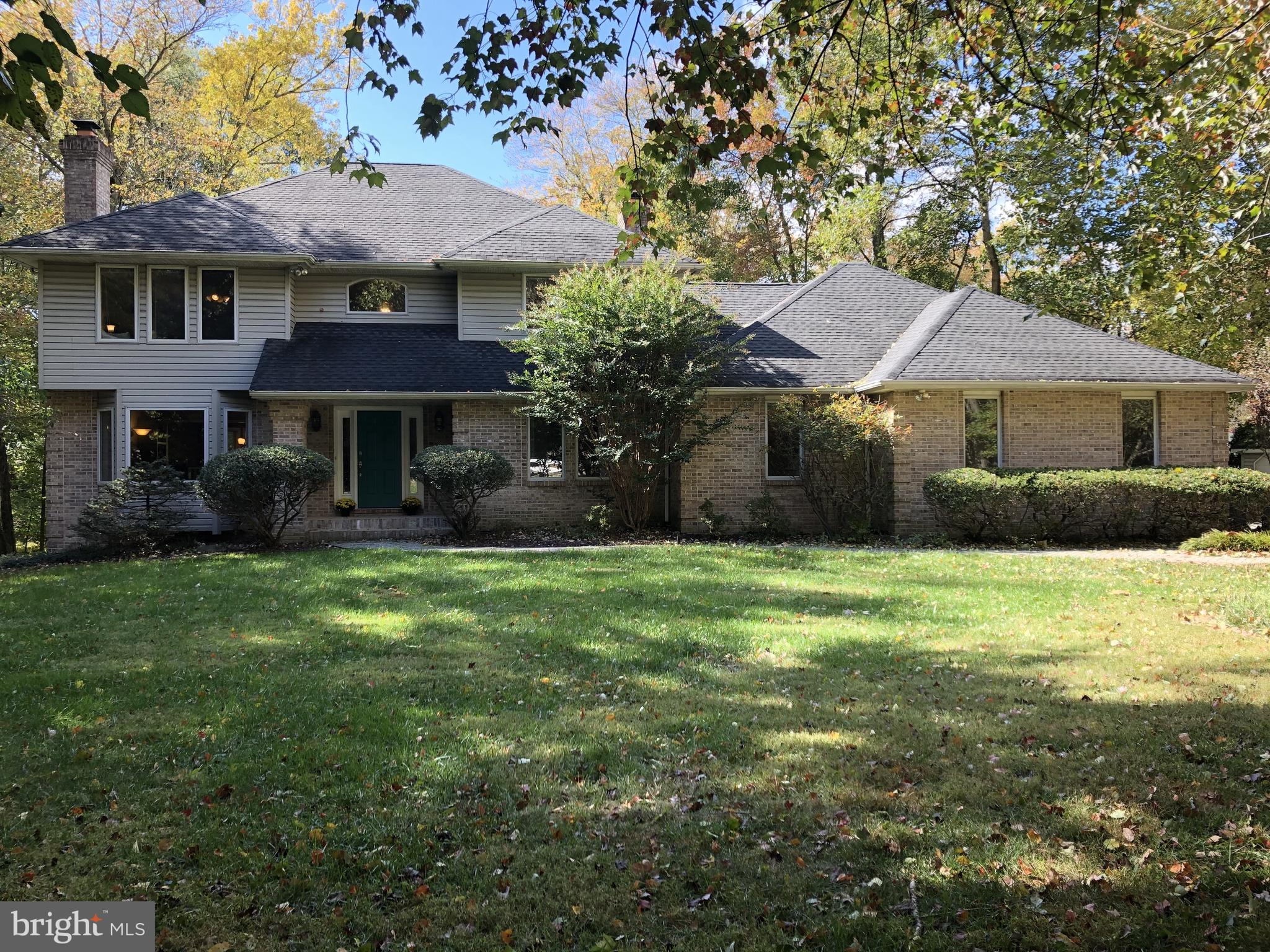 Gorgeous Greenville Colonial in a fabulous location! On a private drive tucked away on a 1.22 acre l