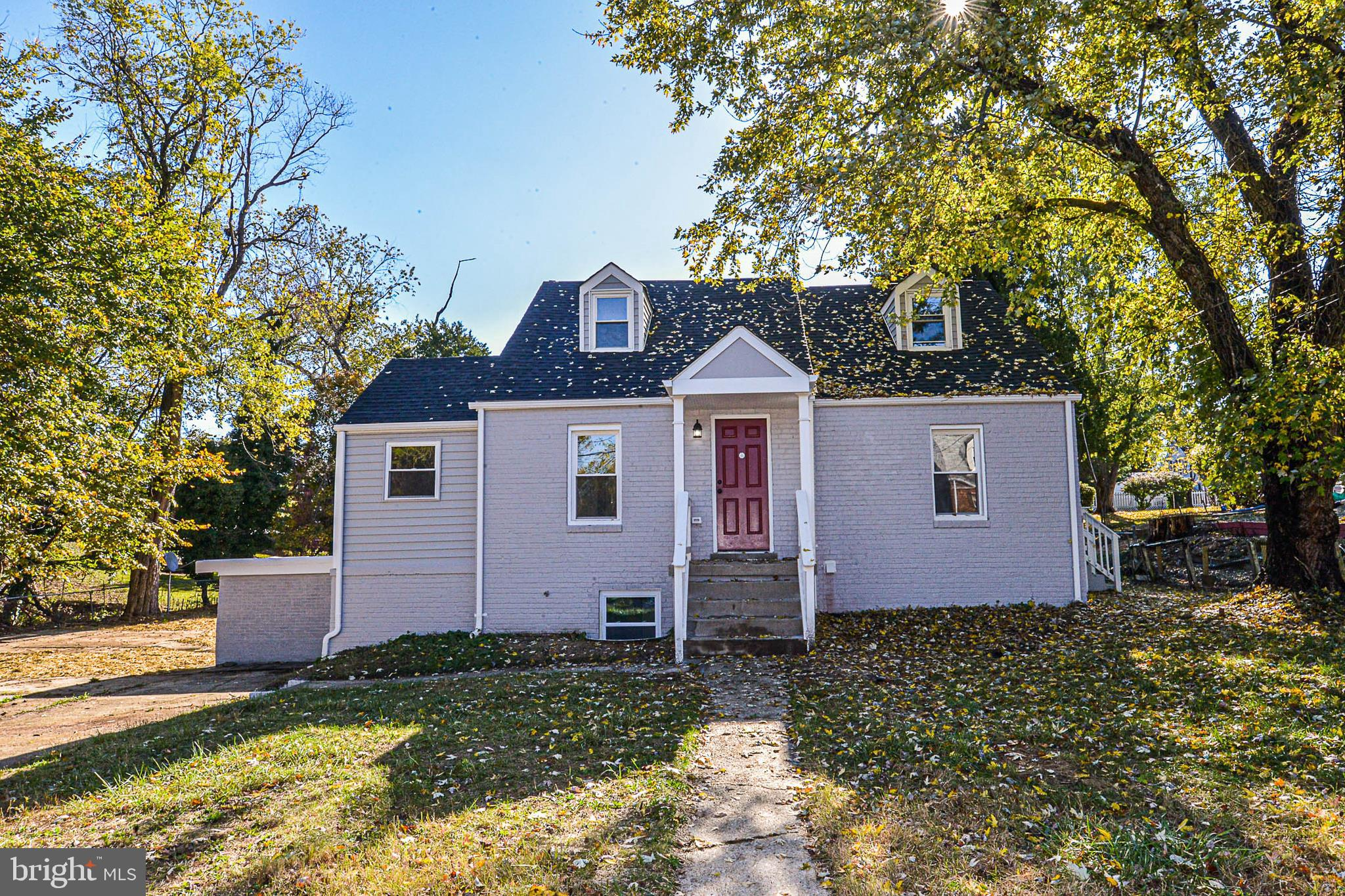 Beautifully renovated house with a half-acre lot sitting at the end of street.  Driveway offers ampl