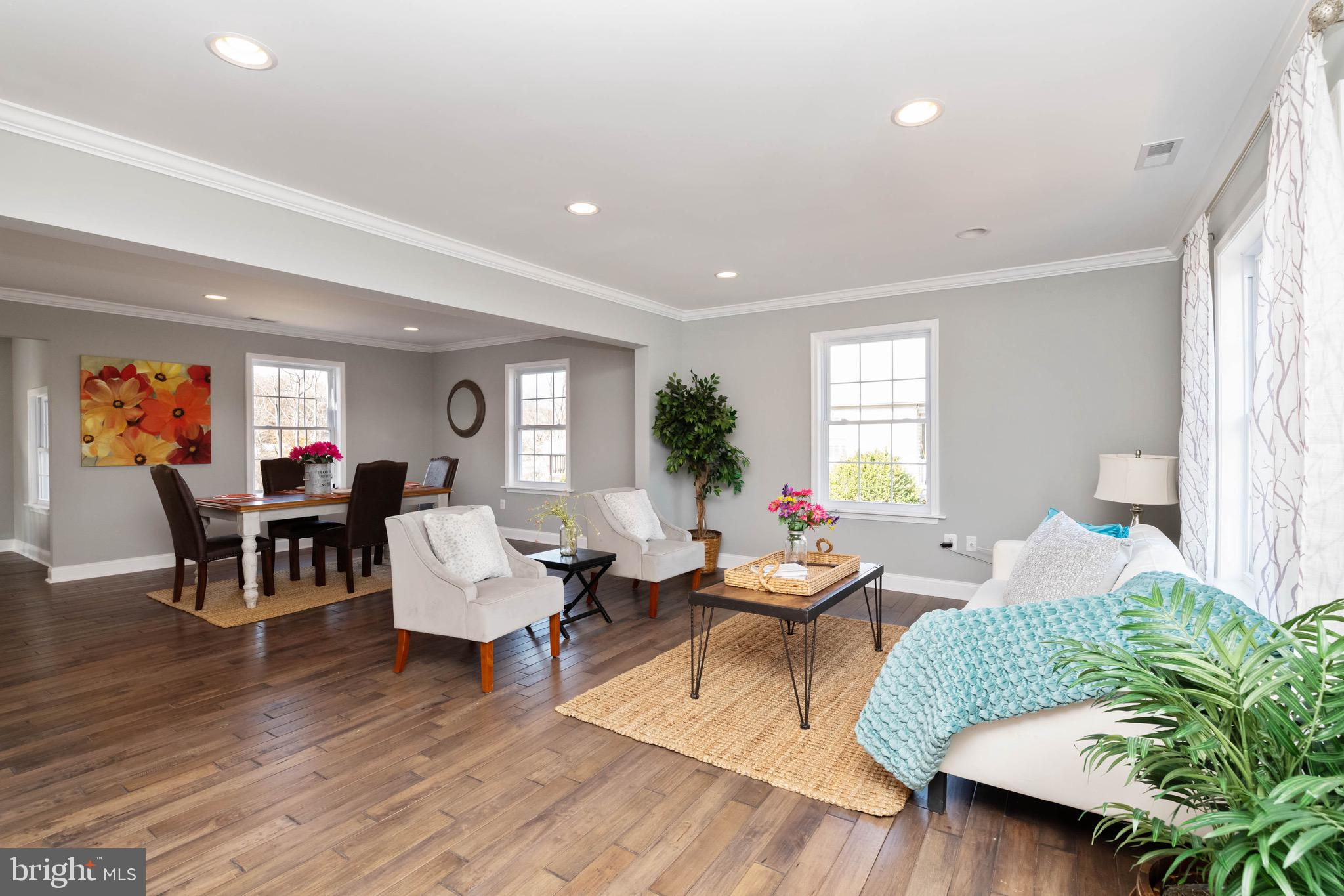 This beautiful newly renovated Cape Cod is so much larger than it appears from the front. A must see