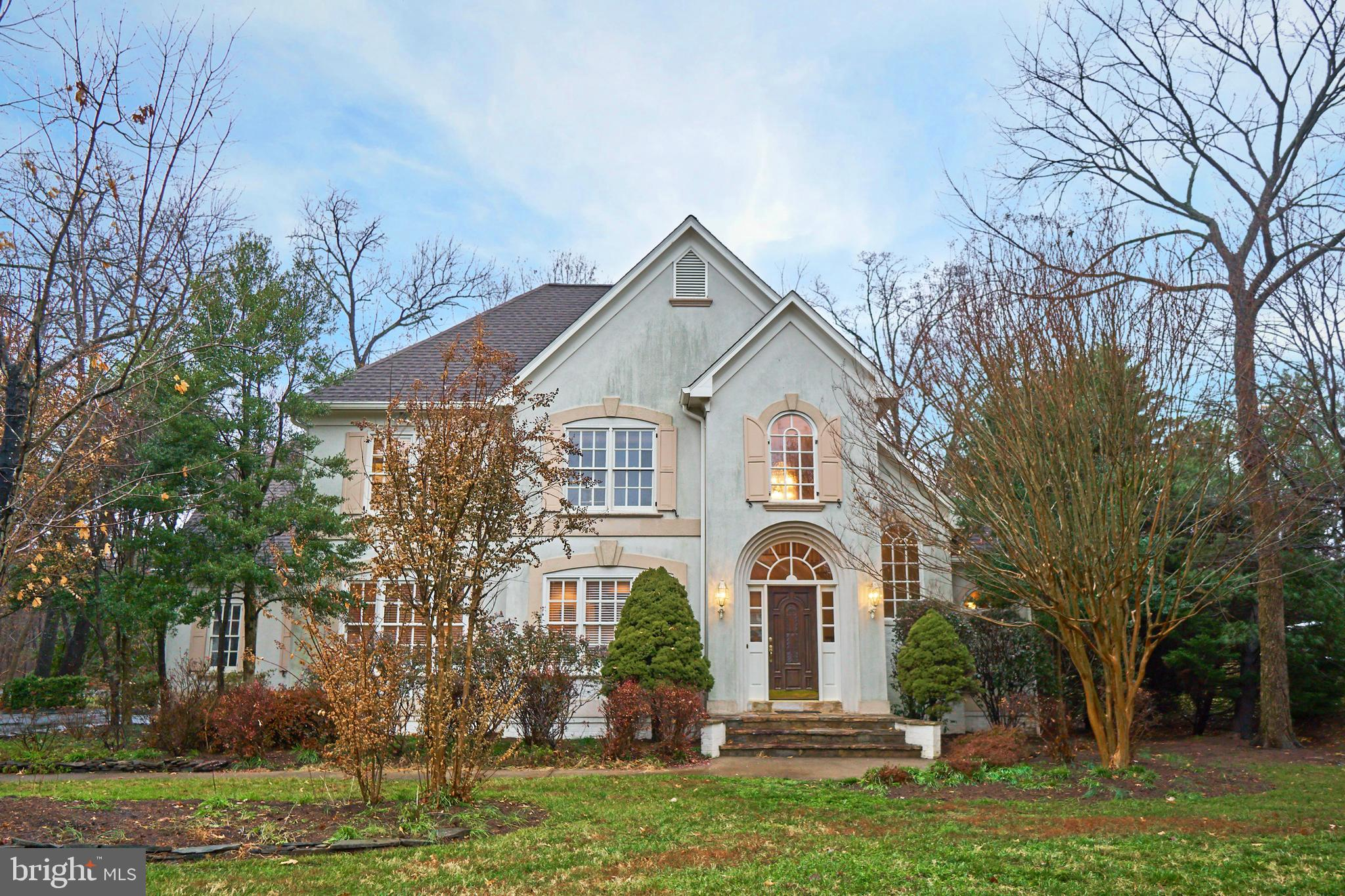 Southern Living Style Stucco home in exclusive gated community of Lake Manassas.  This is a custom b