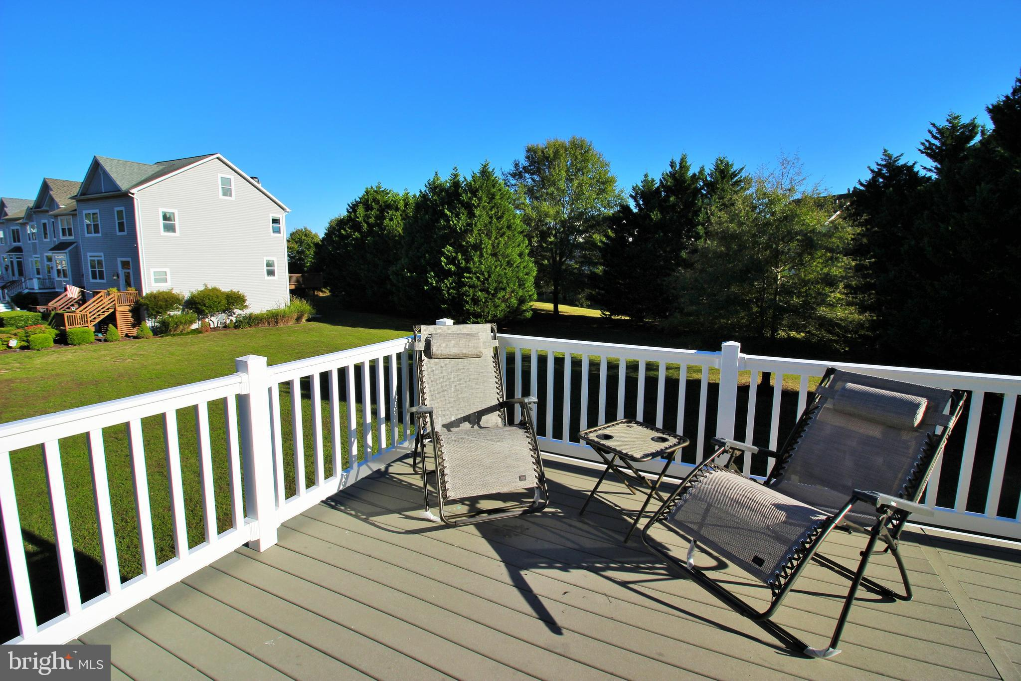 Spacious 4 level, end unit townhouse w/2,354 s.f., features an open floor plan, garage and easy comf