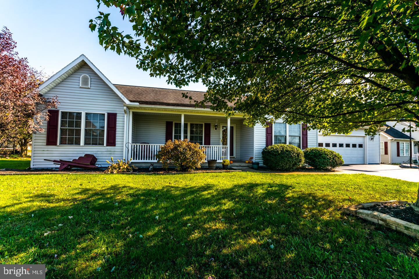 Immaculate Sutton Model Ranch home with split bedroom floor plan in Spring Mills. This location is c