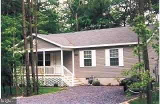 Great 70 ft. wide lot, excellent quiet location. Large covered front porch. Very open, bright & airy