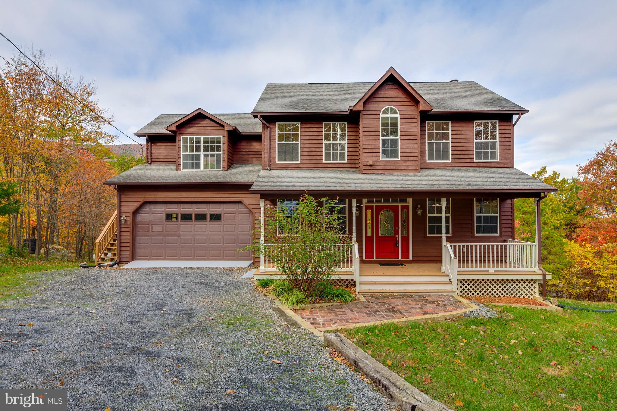 This impeccable home with beautiful views of GW National Park offers 3 bedrooms, 2.5 baths, 2 car garage, Hardwood throughout main and upper level. The kitchen offers a wall oven and cook top. A cozy fireplace in the family room can be gas or wood burning, Spacious master with luxury bath and walk in closet. A bonus room or MIL suite is over  the garage with its own exit. A upper level laundry room and 2 spacious bedrooms. Rec room and den are located in the basement with more room to expand or use for storage. Enjoy the deck while watching the wild life and mountain views. The present owner has owned the home since 2006. The home has been unoccupied during this time period and was winterized. All appliances have been unused during this time frame. The water heater is new and basically unused. The HVAC has not been used for have of it~s life span. The HVAC was recent inspected with new programable thermostats. Septic rated for 3 bedroom. Comcast Xfinity is available.