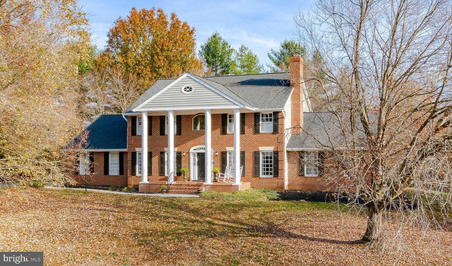 "Perfection in ""The Chase""! This gorgeous brick front estate is perched on a private, elevated lot, e"