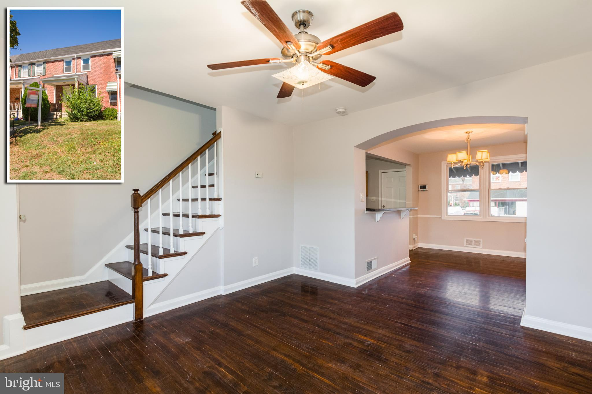 CHARMING PORCH FRONT ROWHOME WITH 3 FINISHED LEVELS & PARKING PAD! Refinished hardwood floors throug