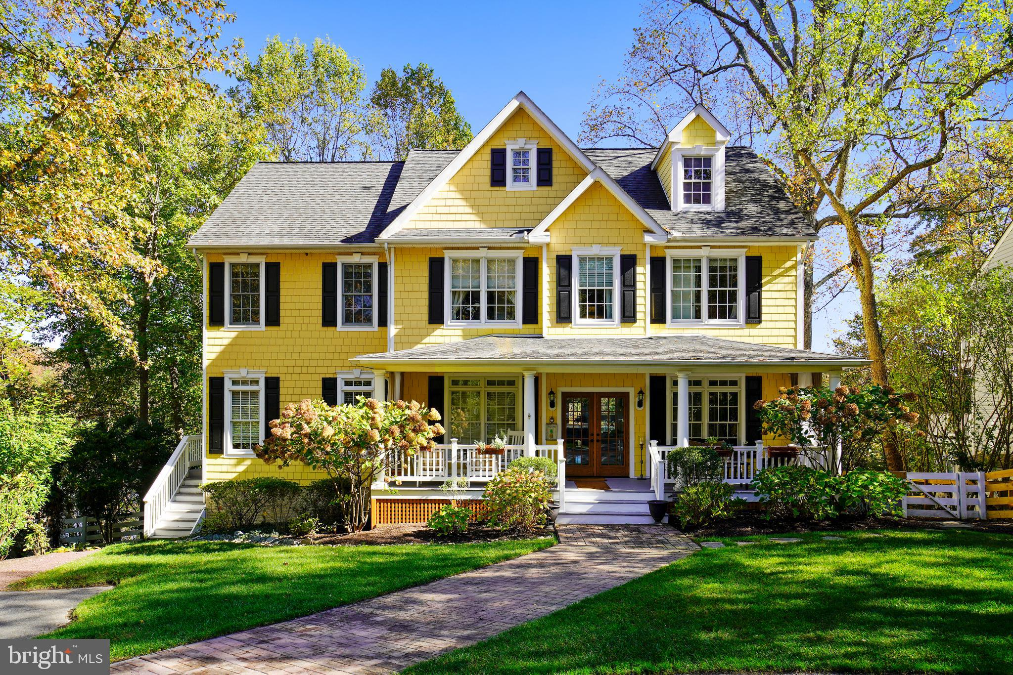 This spectacular waterfront Southern  Colonial with its welcoming front porch and multiple decks  ha