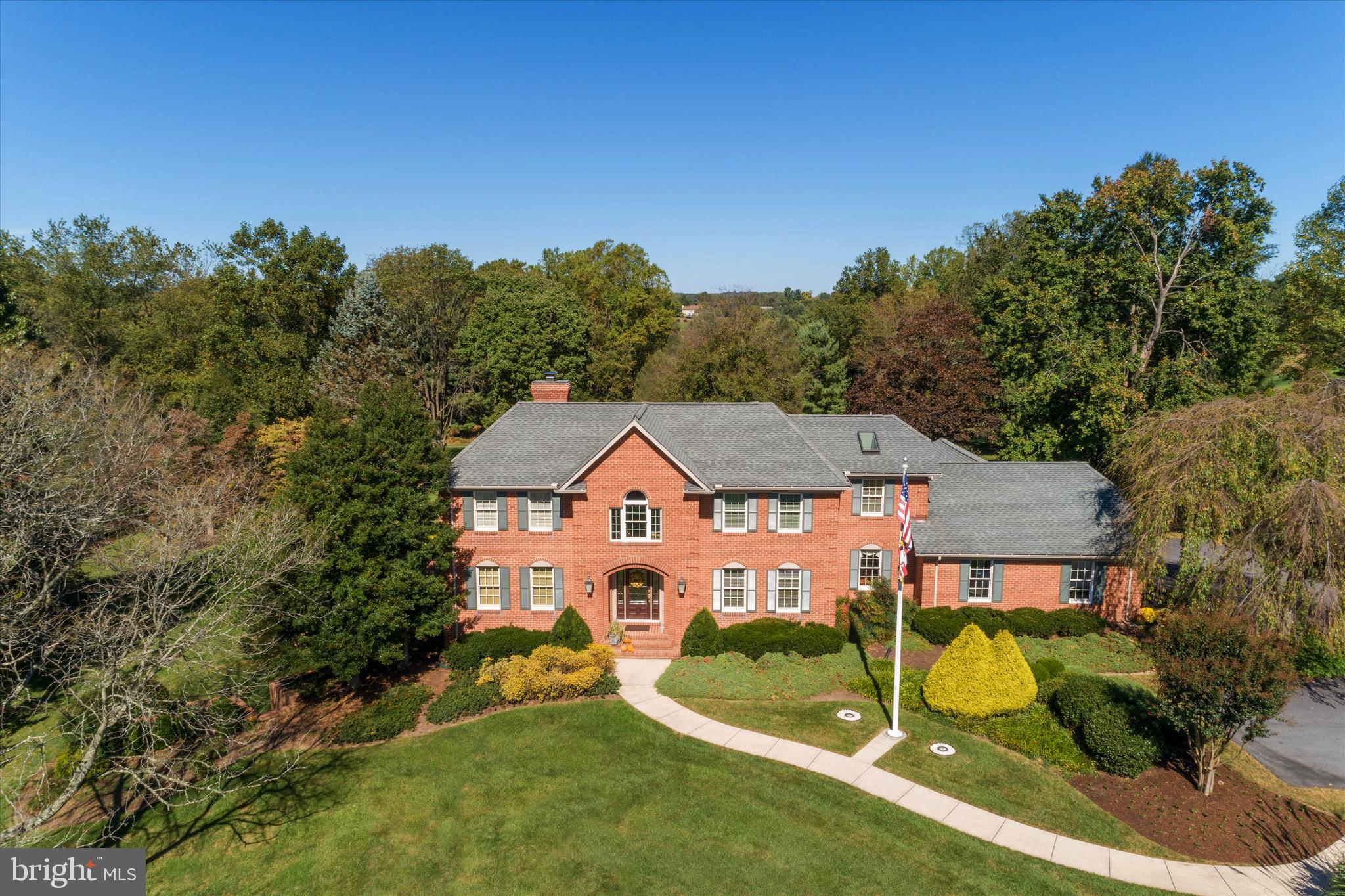 Stunning All Brick Custom Gem in The Greens! Located on nearly 2 acres with striking views of the co
