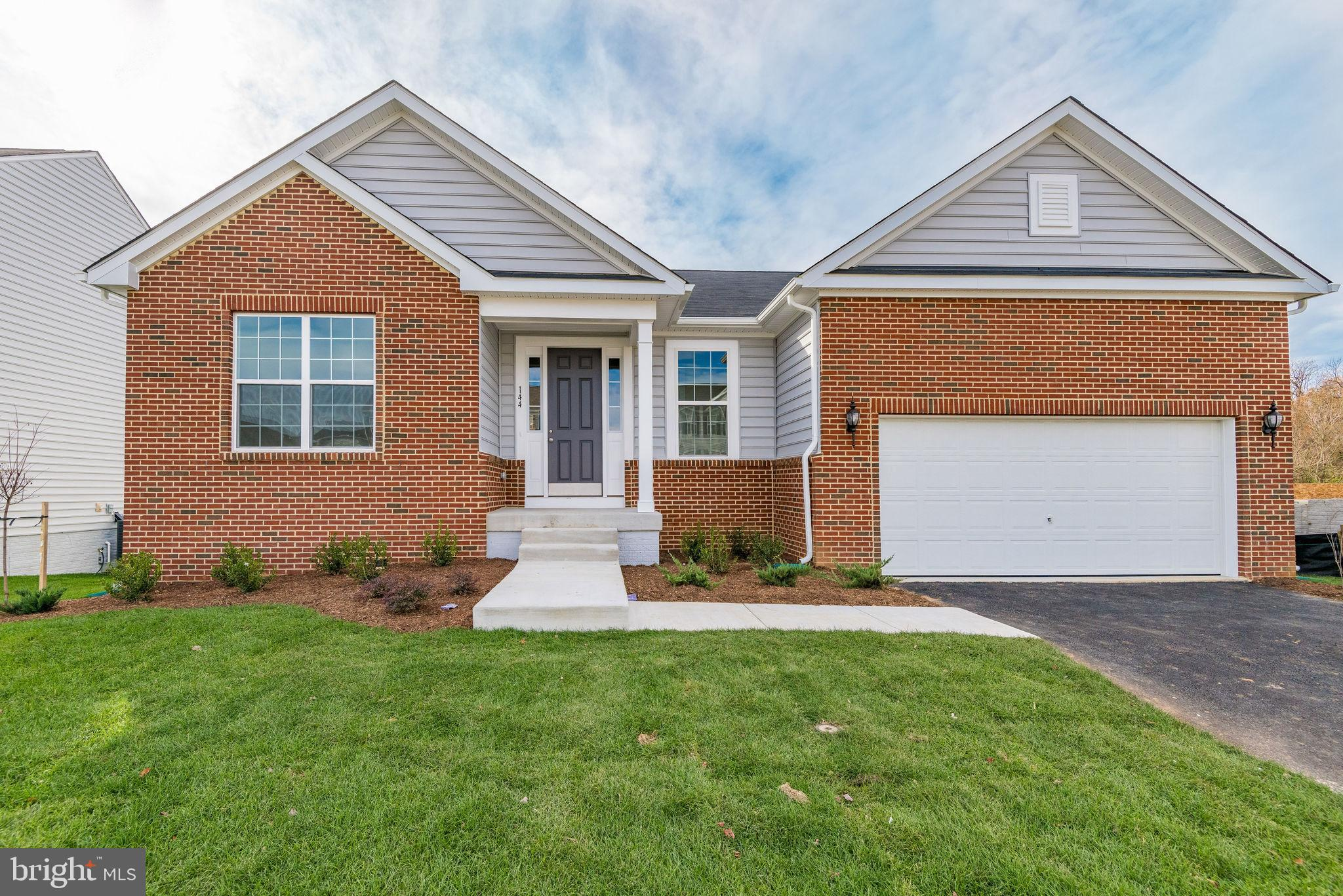 This home is brand new and ready for you to move in!!! Main level living with hardwood floors, full