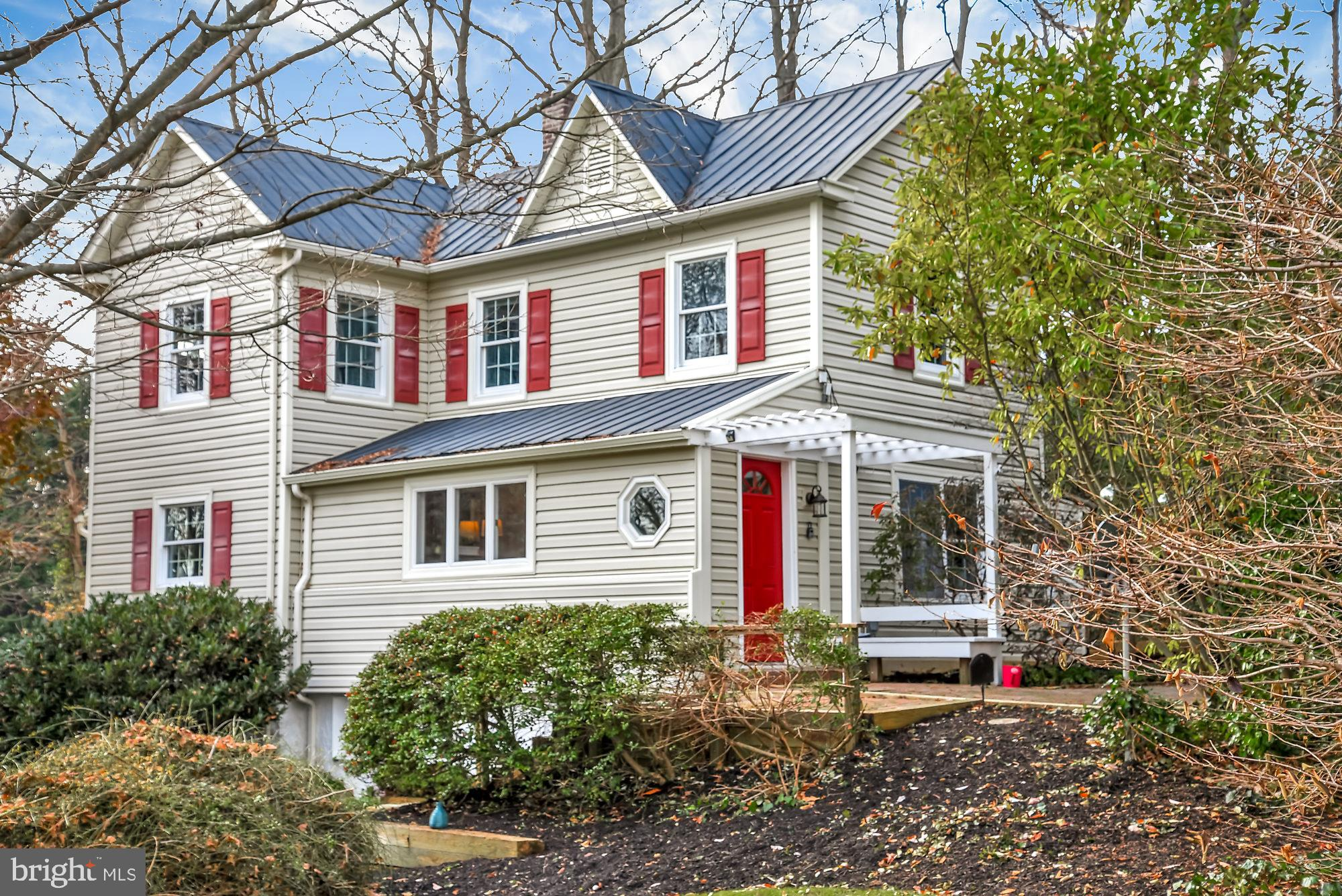 STUNNING ICONIC COLONIAL FARMHOUSE in Woodbine perched on 1.73 acres with so much charm and characte