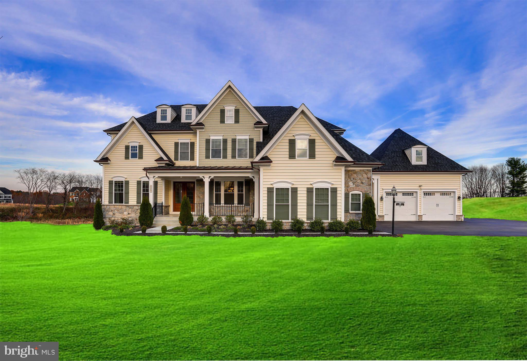 Impressive estate nestled on two acres of land featuring 5 bedrooms, 4 full and 2 half bathrooms. Th
