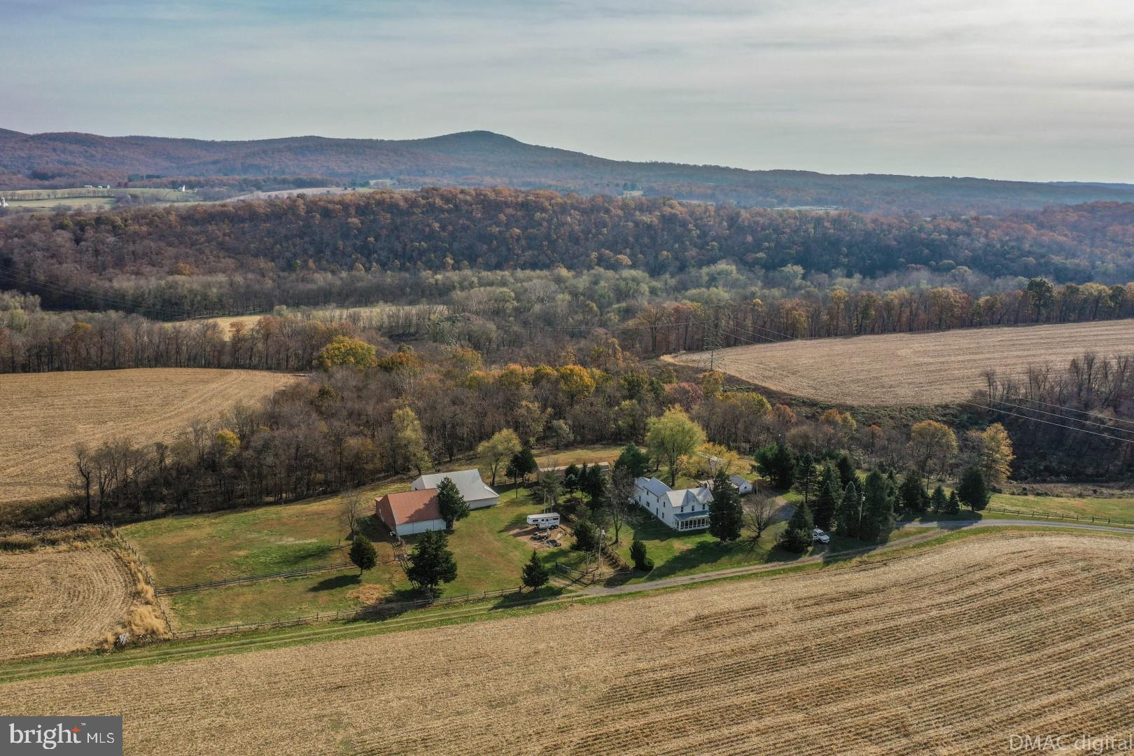 Large 128 +/_ Farm (Two parcels) in Southern Frederick County. Includes 60+/- tillable acres, 64+/-