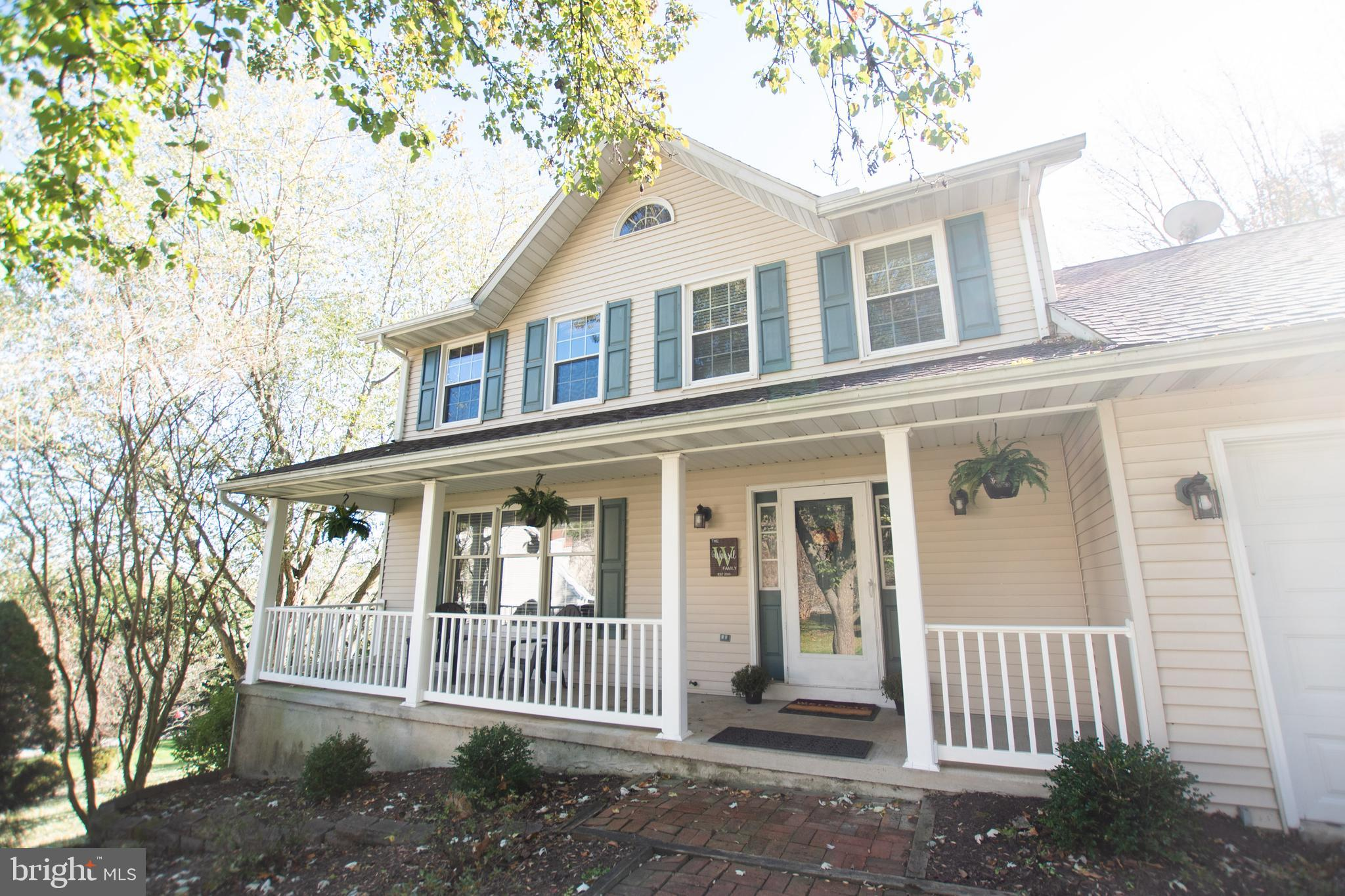 4-bedroom colonial tucked back on a peaceful 1-acre lot, and waiting for you.  Welcome to this lovin