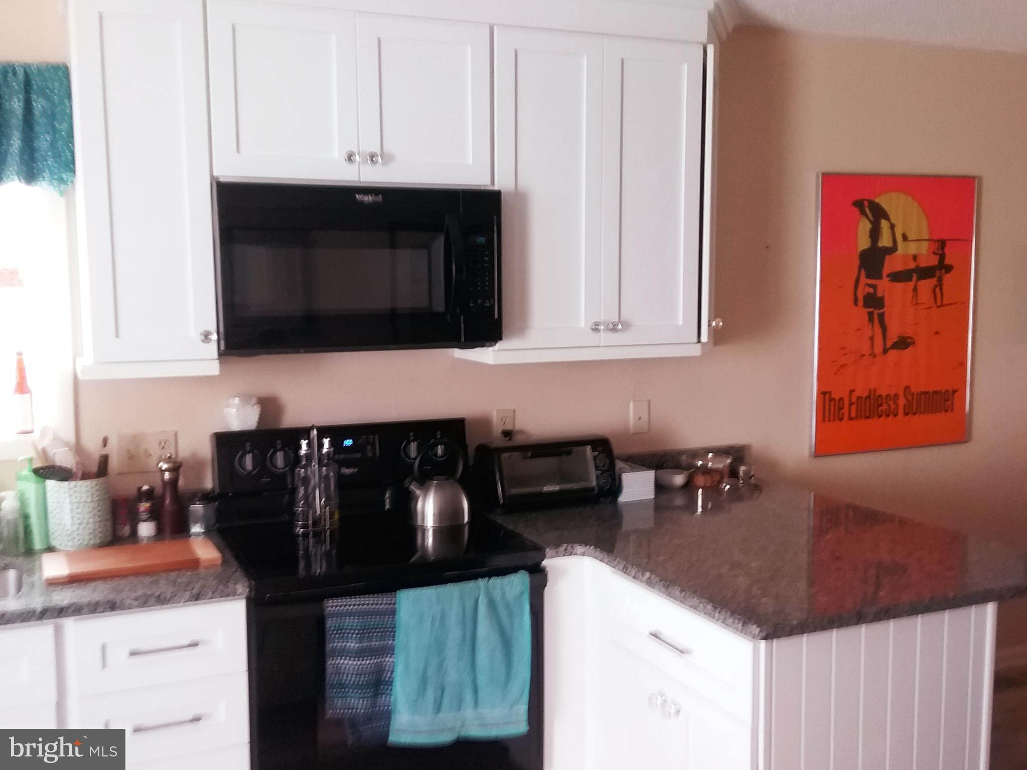 A must see re-modeled southern end unit. NEW KITCHEN and beautiful flooring. Newer HVAC. All this in