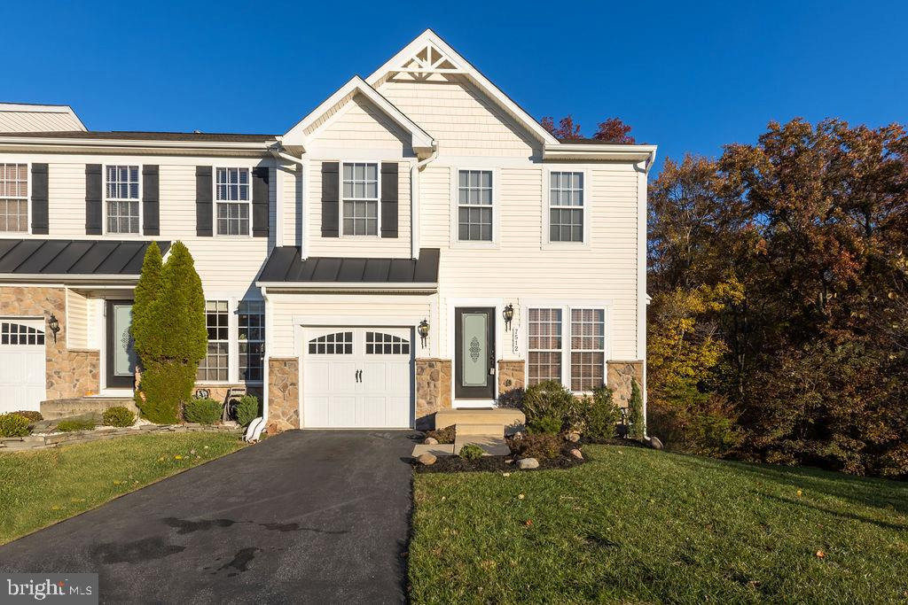 Gorgeous end unit, garaged,  townhome in the well established Villages of Dorchester.  This home sit