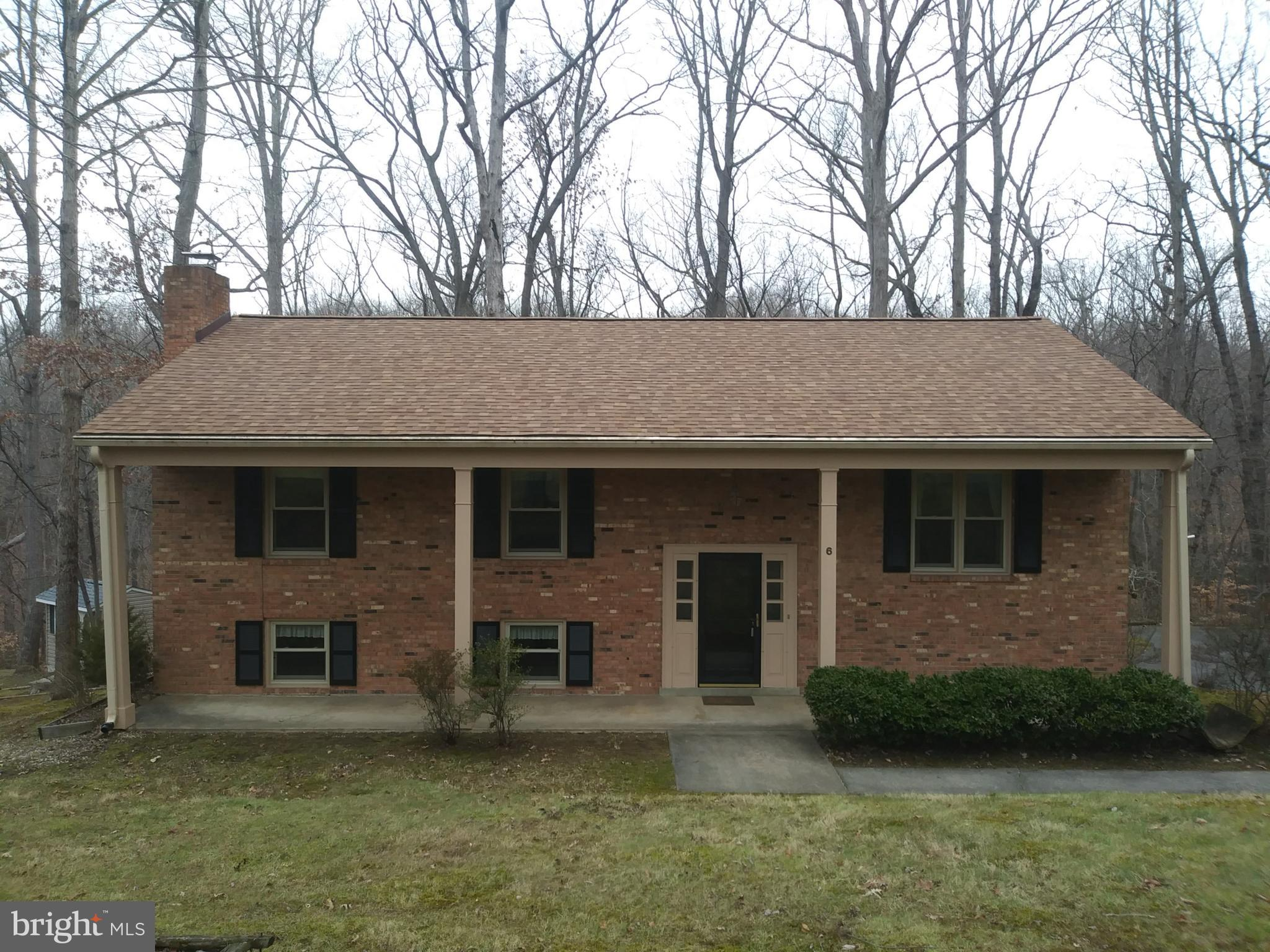 All Brick, 5 bedroom, 3 Bathroom home, with NO HOA , in a great location, on over half an acre! This