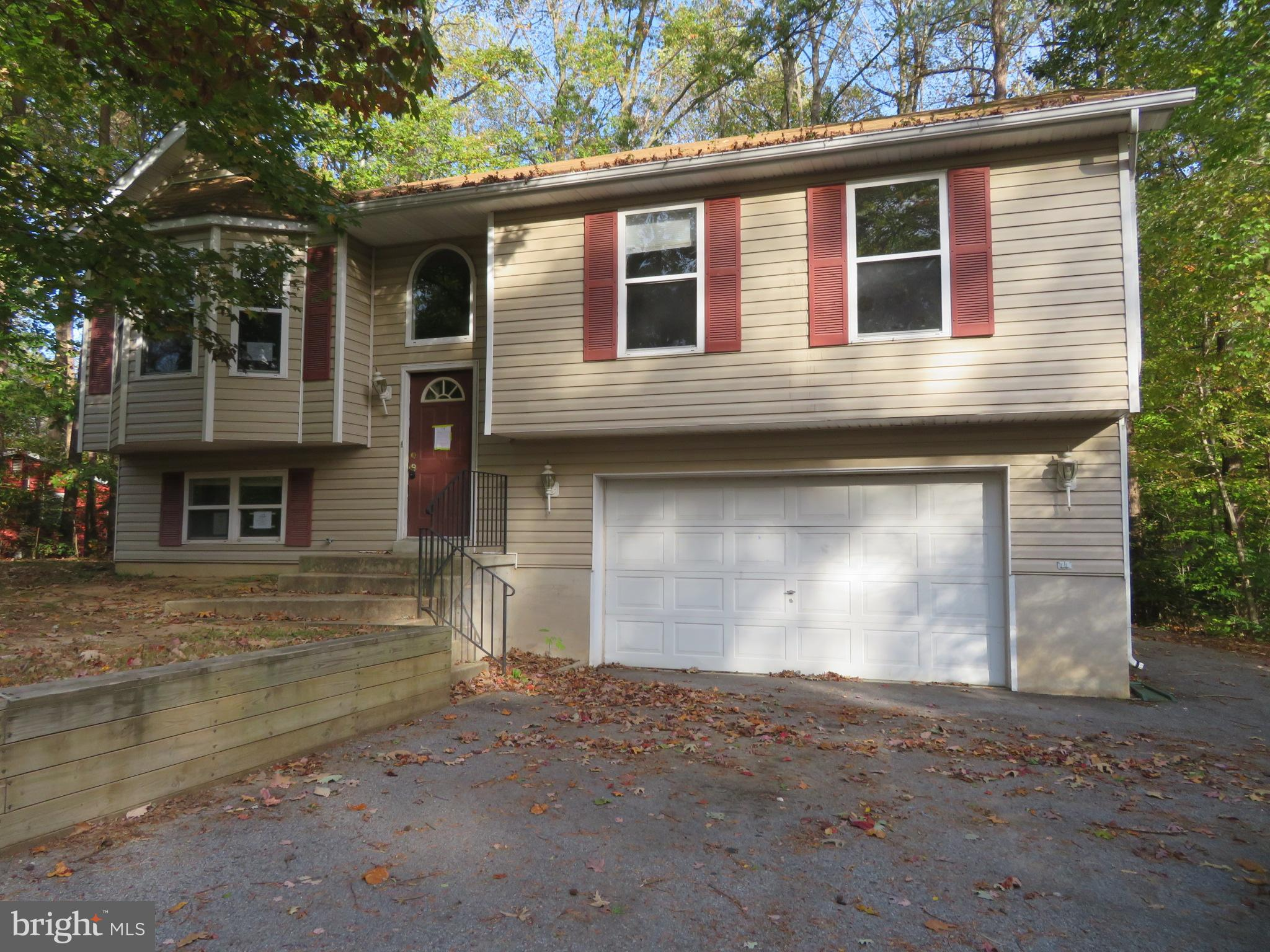 Great value, Split Foyer home, 3 bedrooms, 2.5 baths, attached 2 car garage, rear deck. House locate
