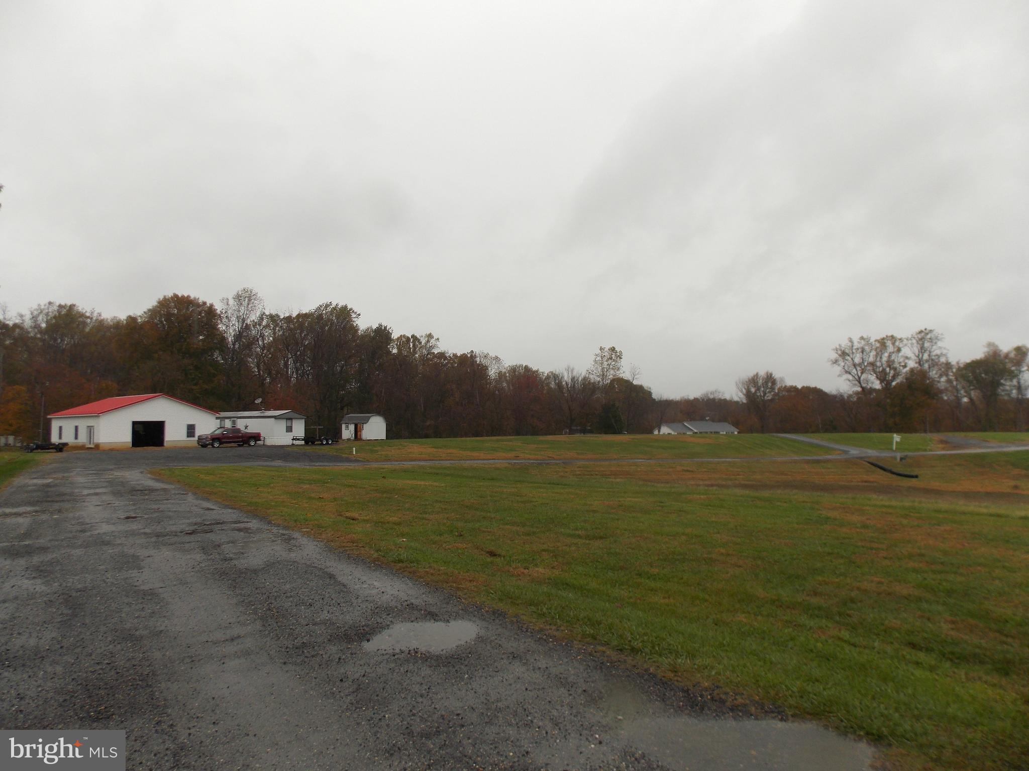 3 Bedrooms 2 Bath Trailer with 6 car garage! BEAUTIFUL piece of property to build your dream home. L