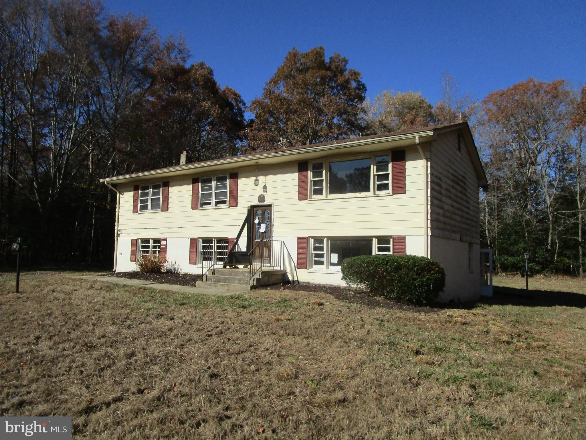 This fixer upper will surely catch your attention.  On Poplar Hill Road sits this 1 acre split level