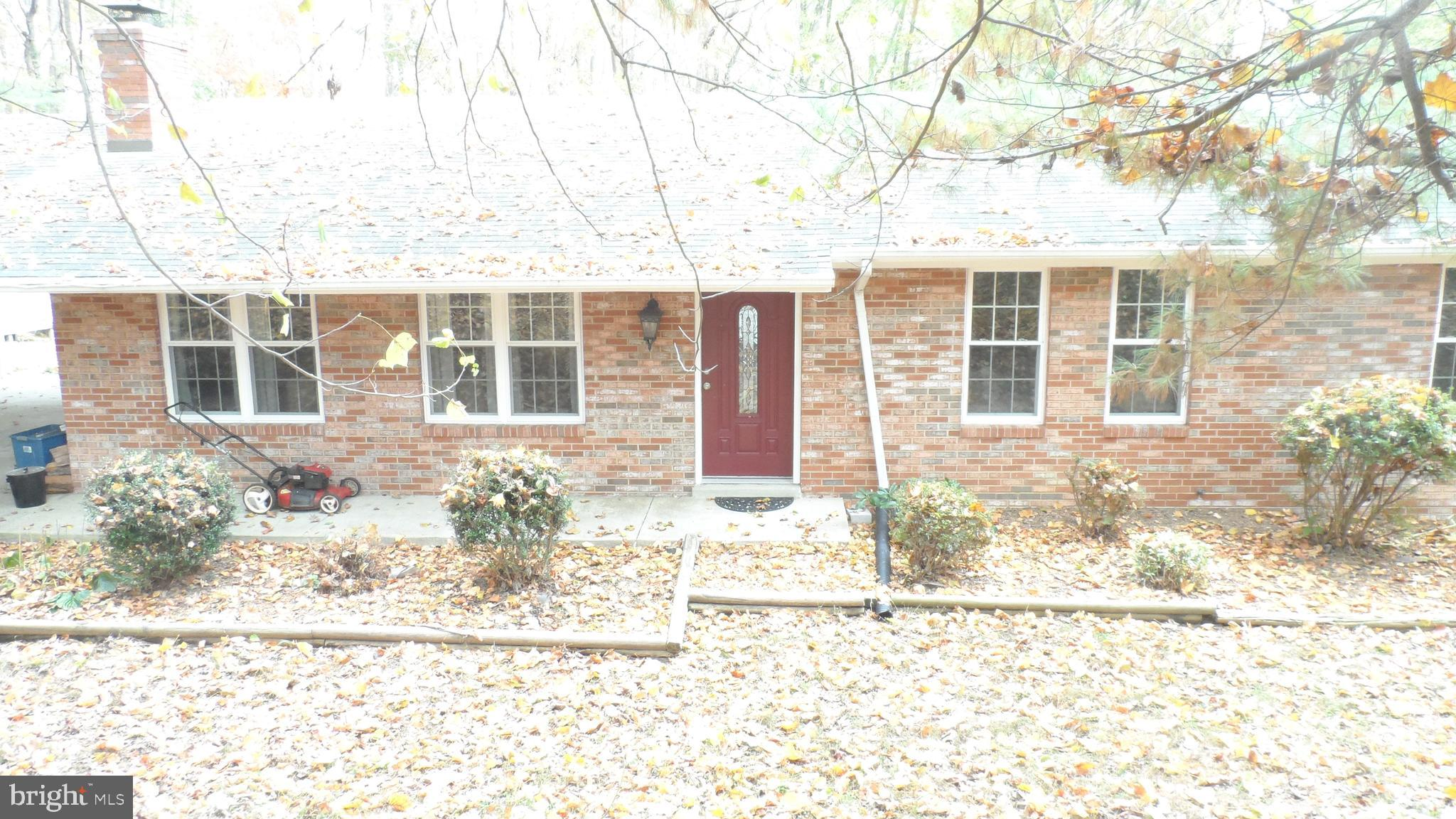 This  home is located in  a popular northern area of the County. It is 1.1 Acre, quiet & private , b